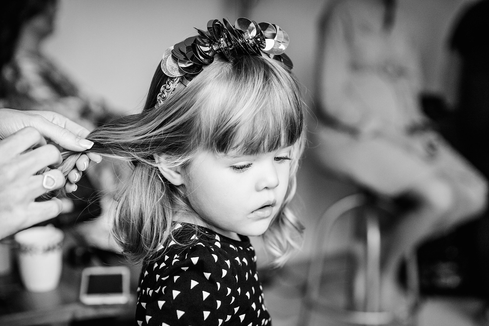 Fun London Wedding flower girl has her hair done