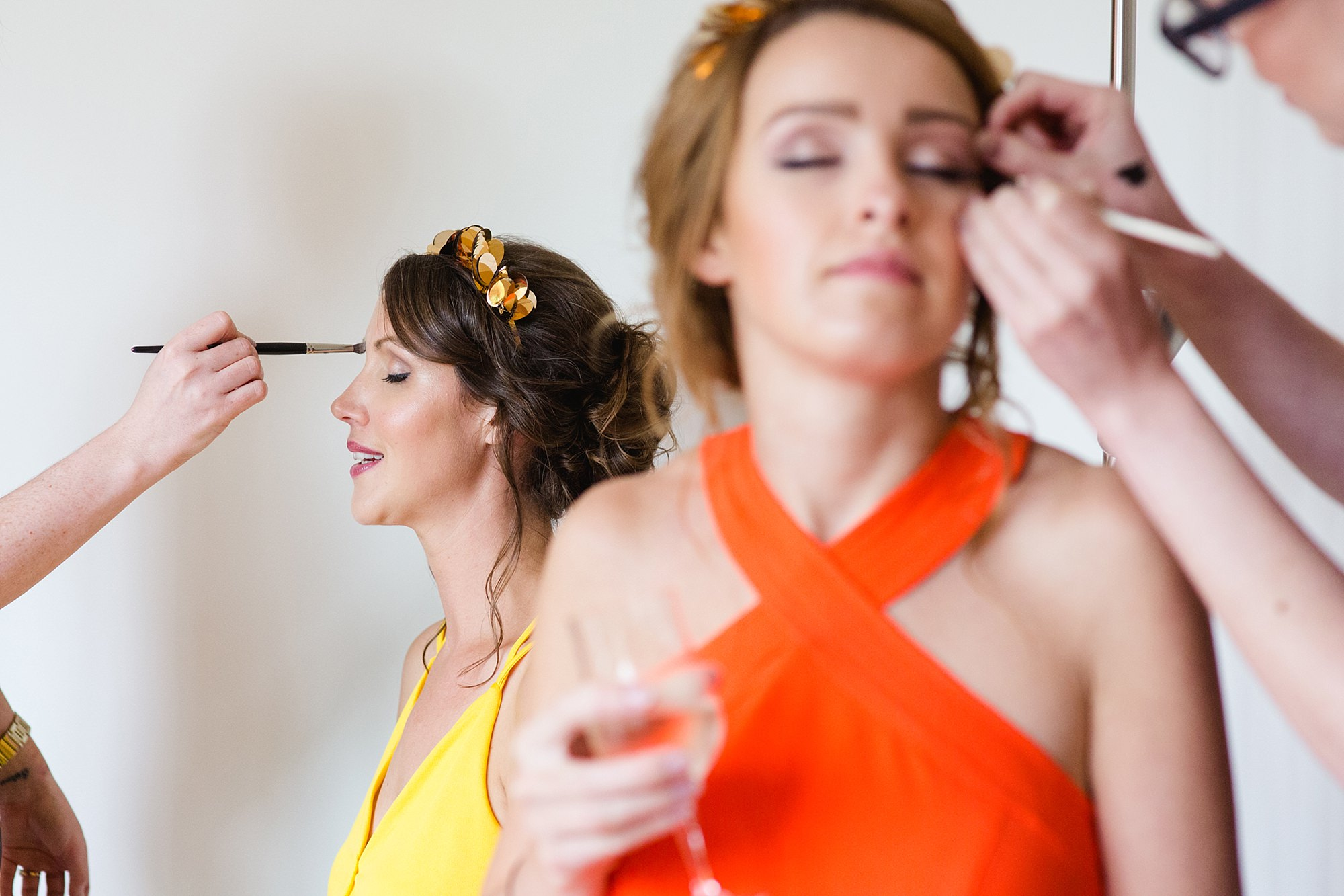bridesmaids having their makeup applied