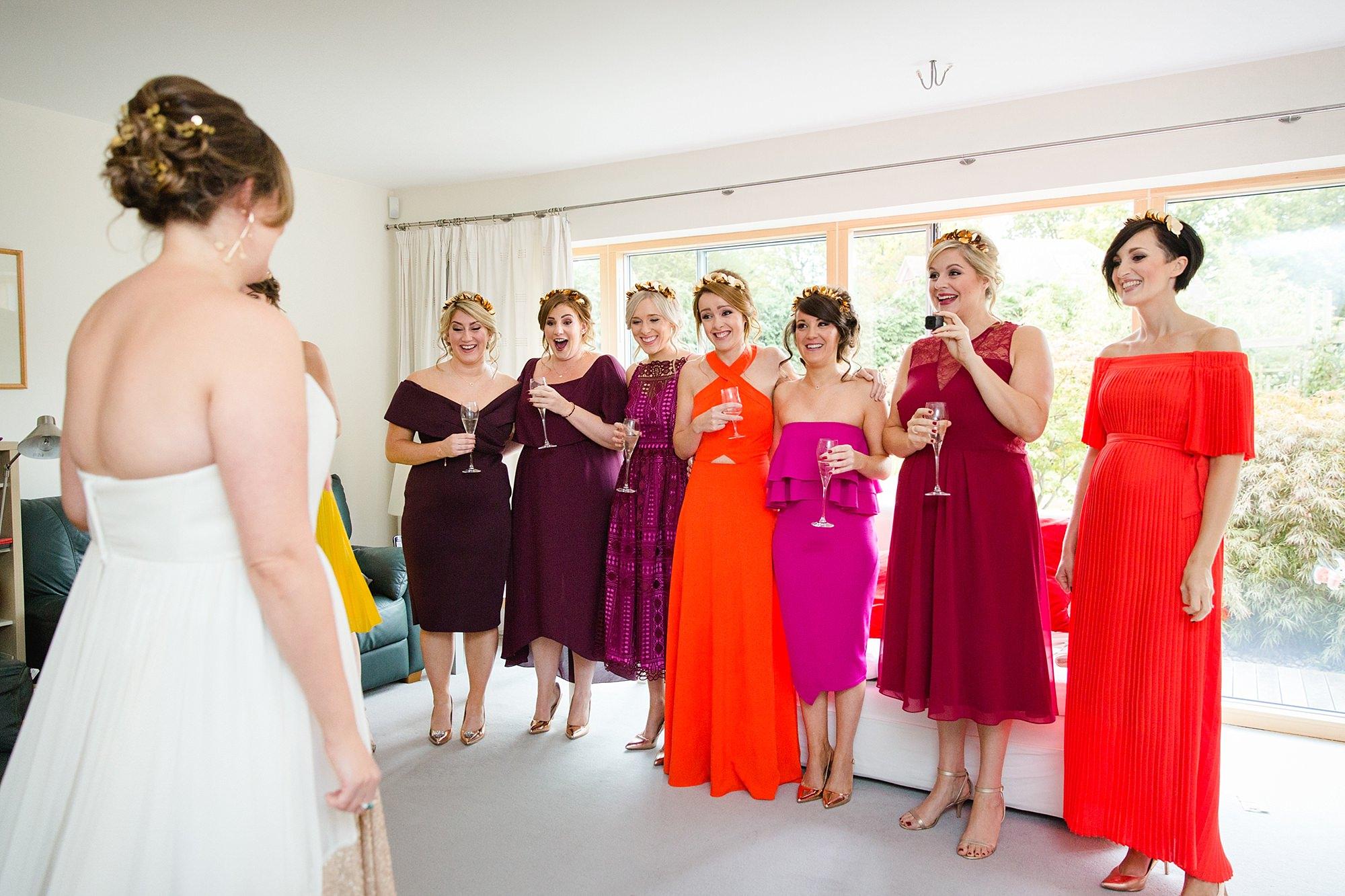 Fun London Wedding bridesmaids react to the bride in her dress