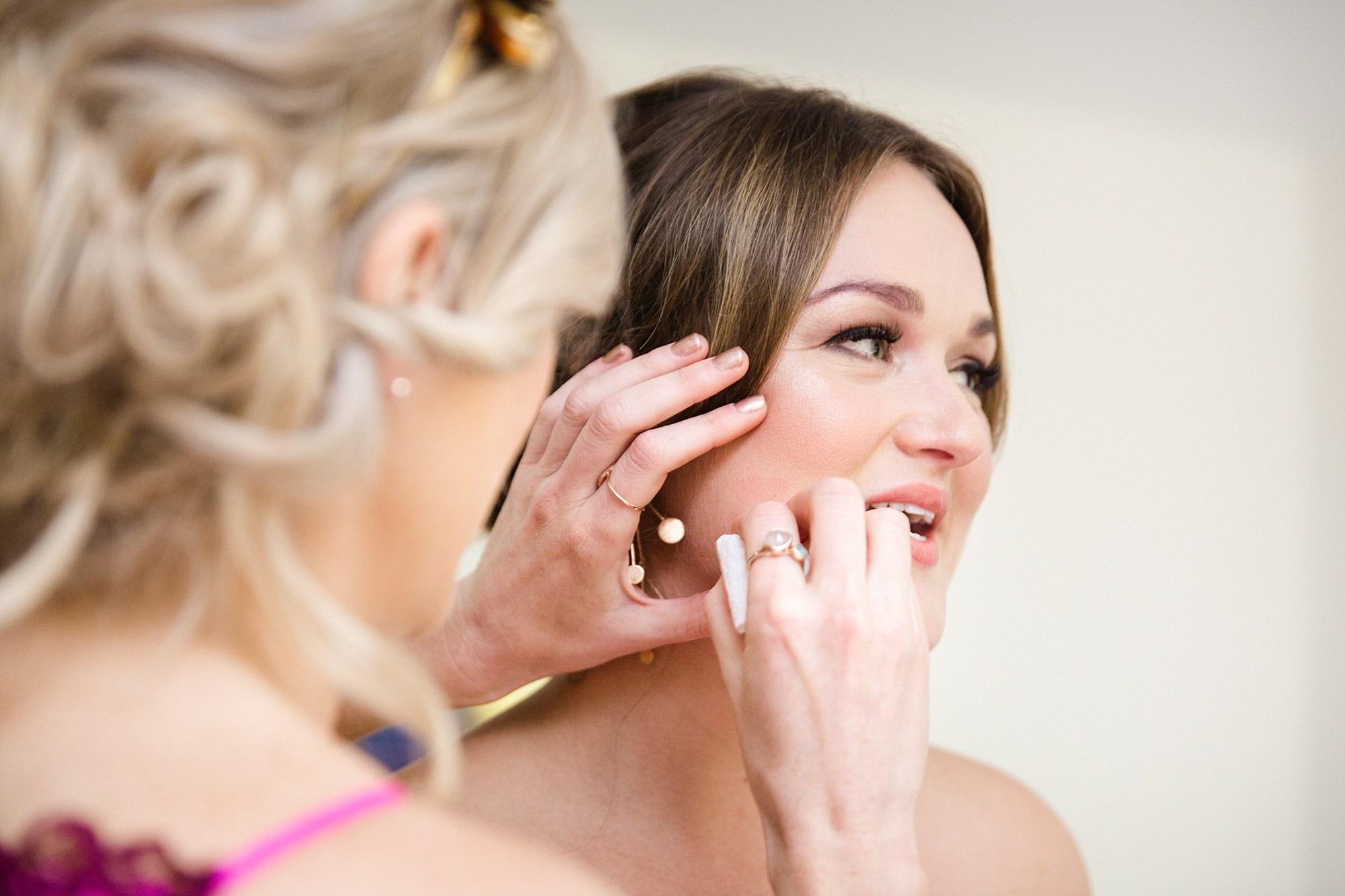 Fun London Wedding bridesmaid wipes lipstick kiss off bride's cheek