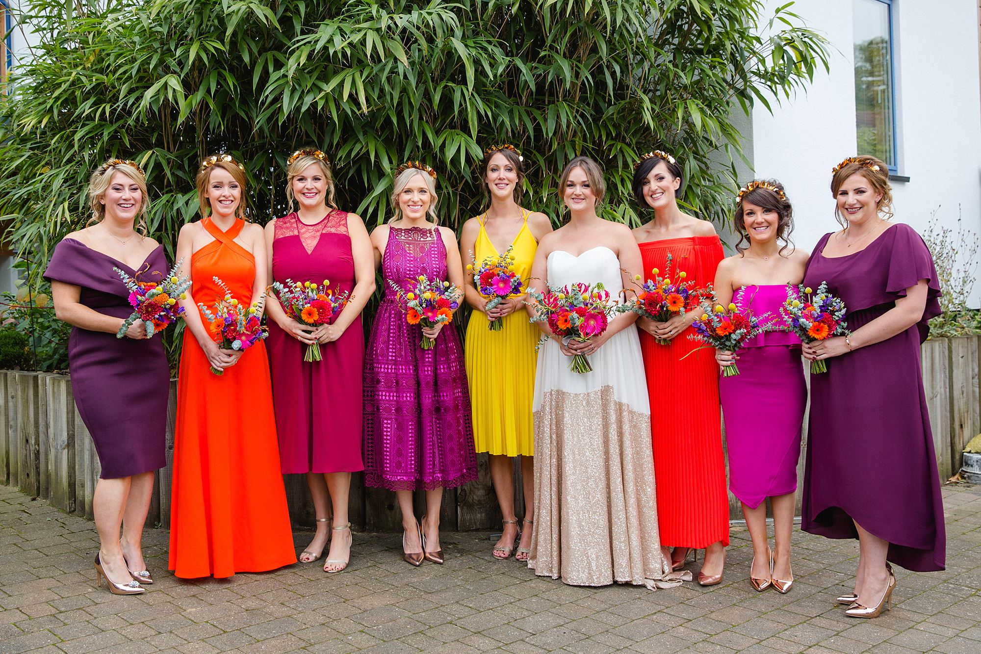 Fun London Wedding portrait of bride and bridesmaids together in colourful dresses