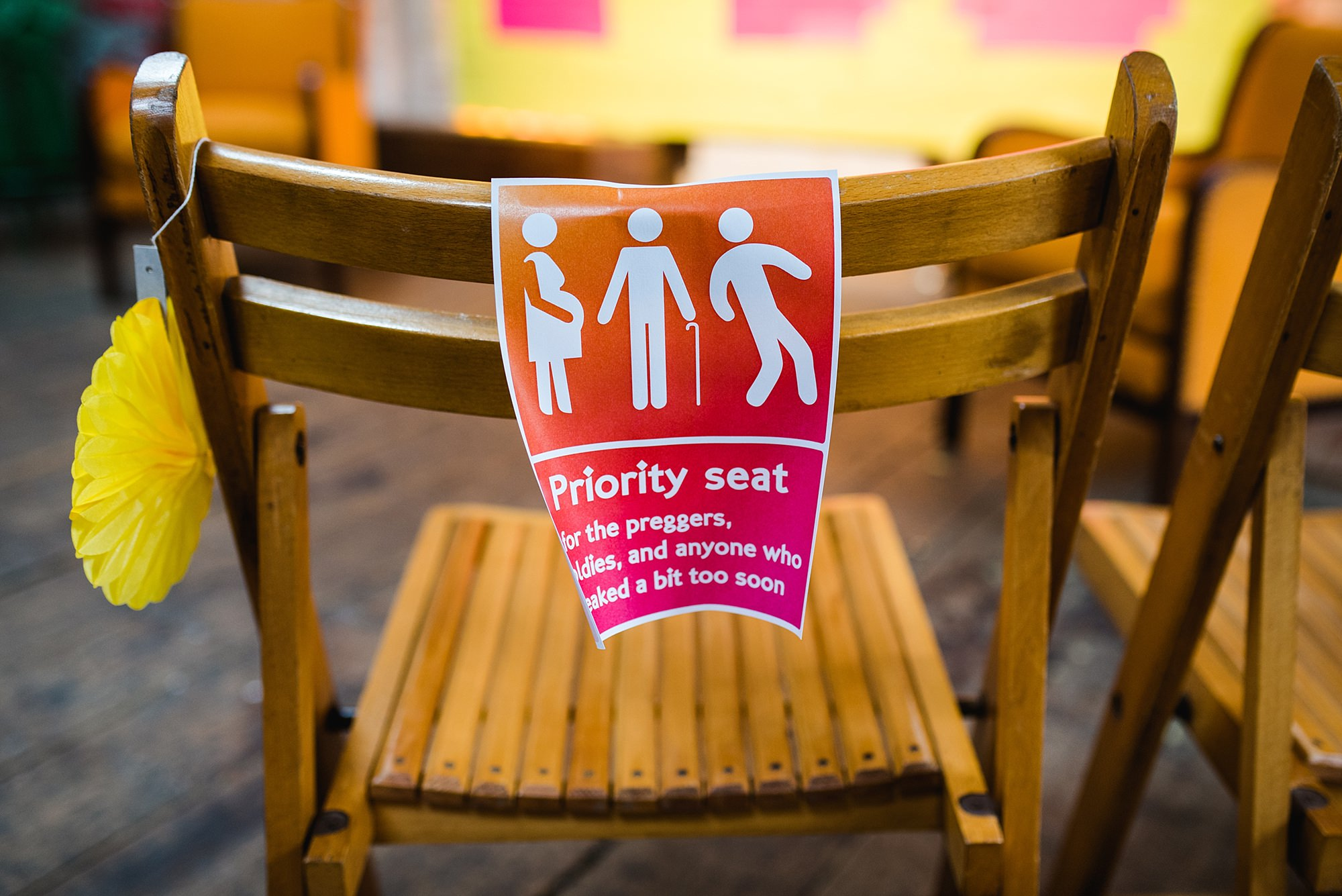 Fun London Wedding funny priority seat sign at brixton east
