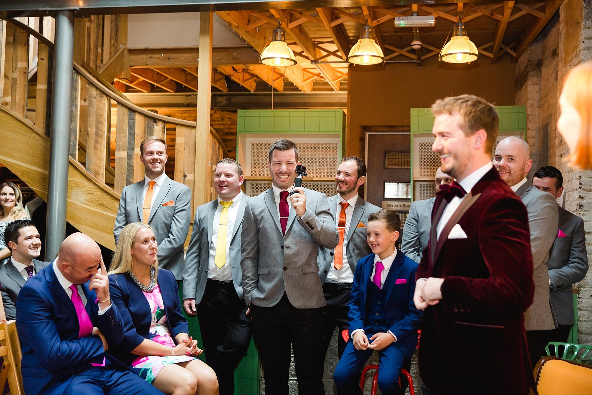 Fun London Wedding portrait of groomsmen with go-pro camera