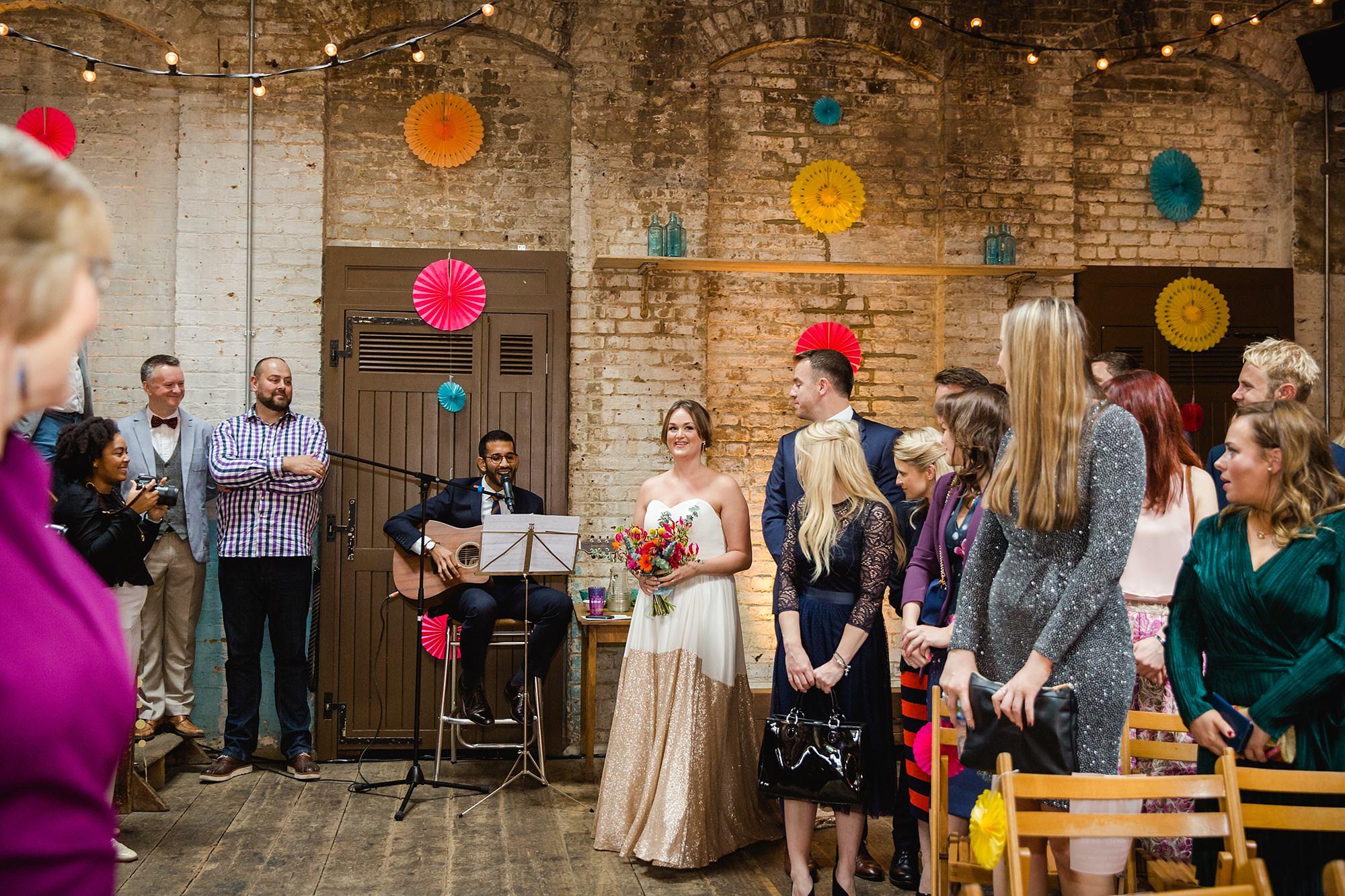 Fun London Wedding bride walks down the aisle at brixton east