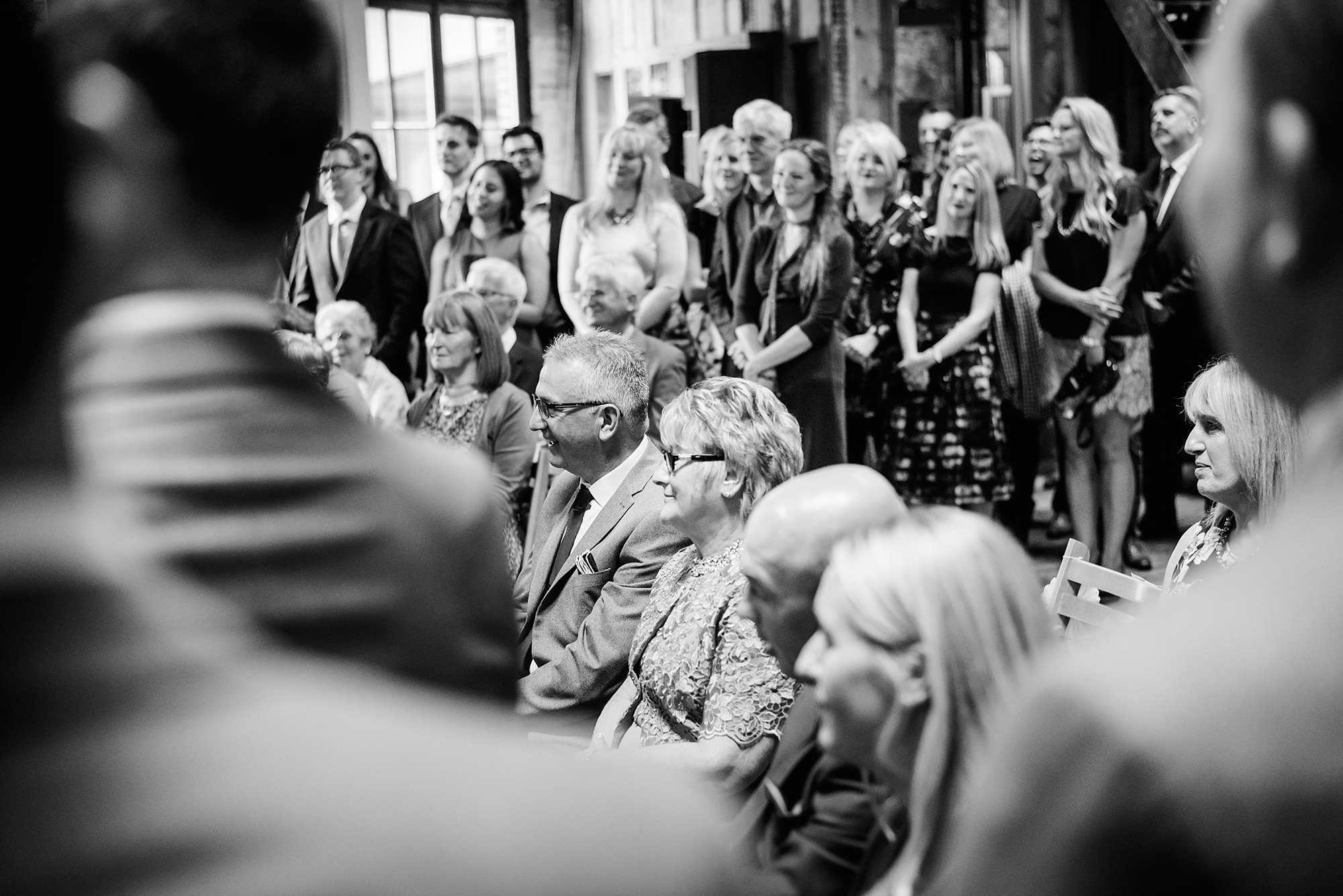 Fun London Wedding portrait of guests watching ceremony at brixton east
