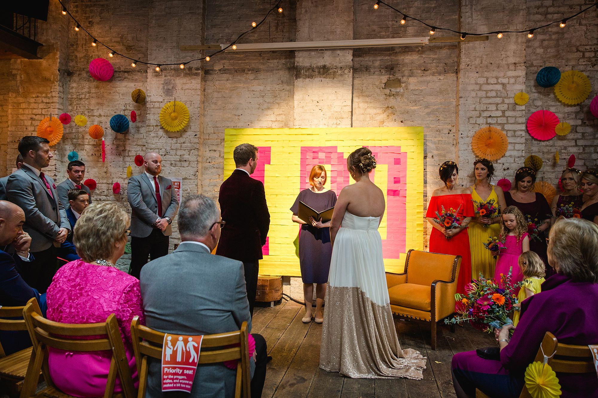 Fun London Wedding a celebrant conducts the ceremony at brixton east wedding