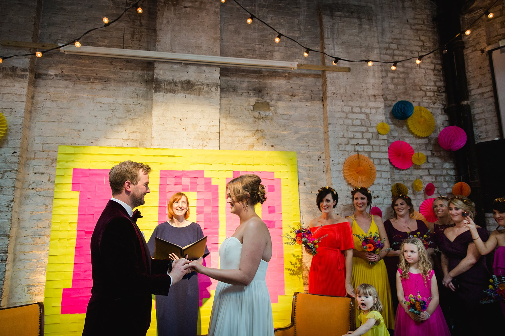 Fun London Wedding bride and groom say vows to each other
