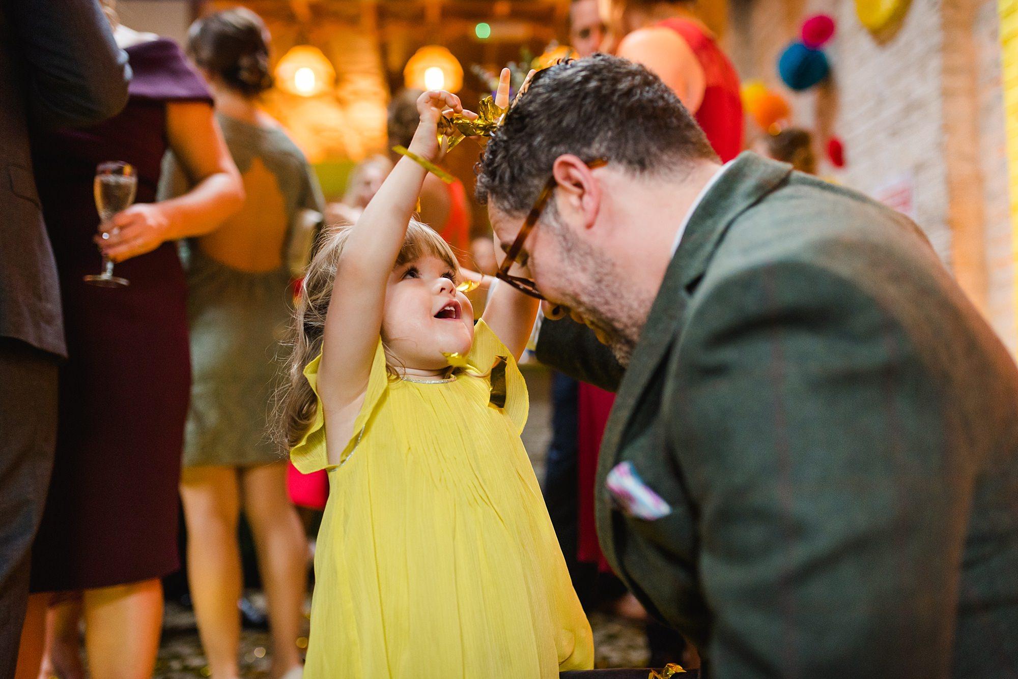 Fun London Wedding flower girl puts confetti in her dad's hair