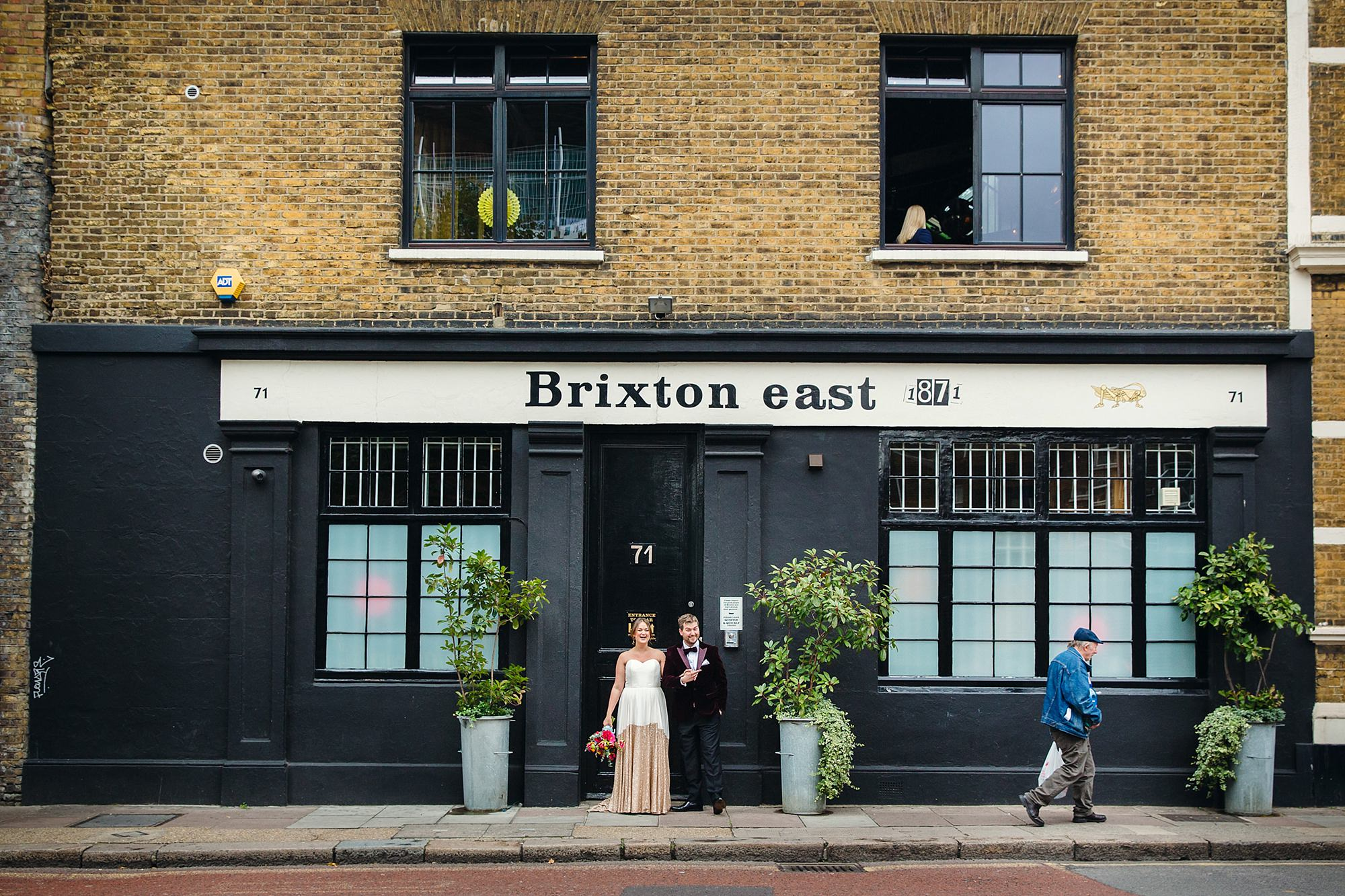 Fun London Wedding portrait of bride and groom together outside brixton east