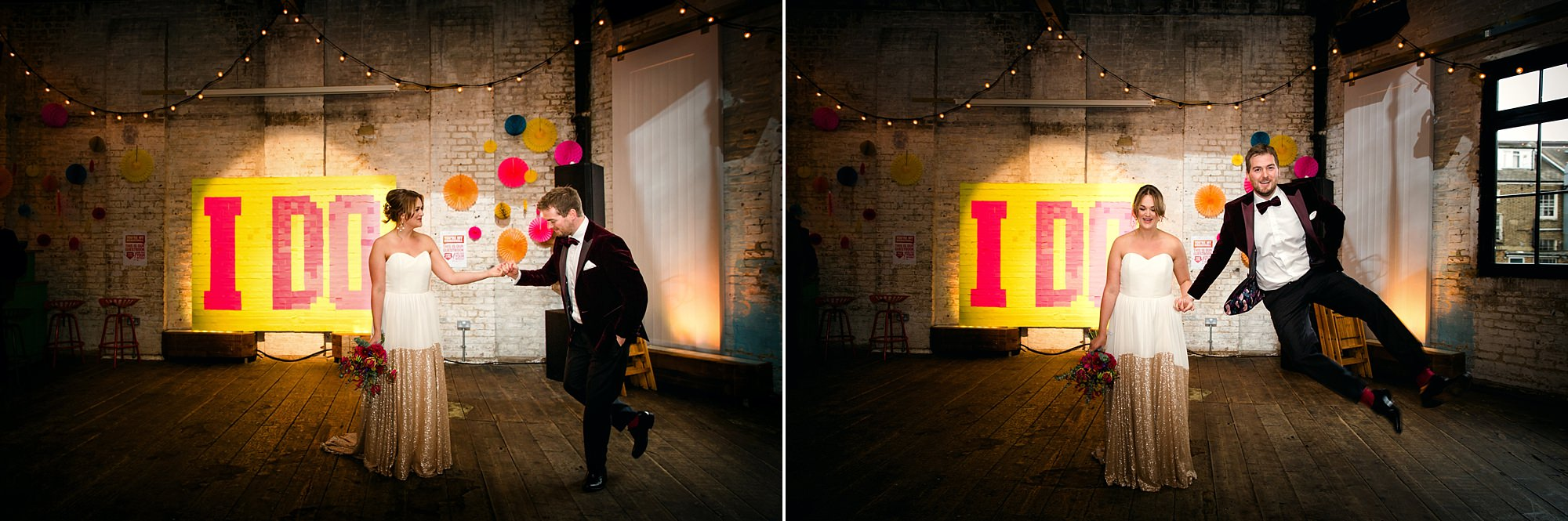 Fun London Wedding portrait of bride and groom dancing in front of giant post it note sign