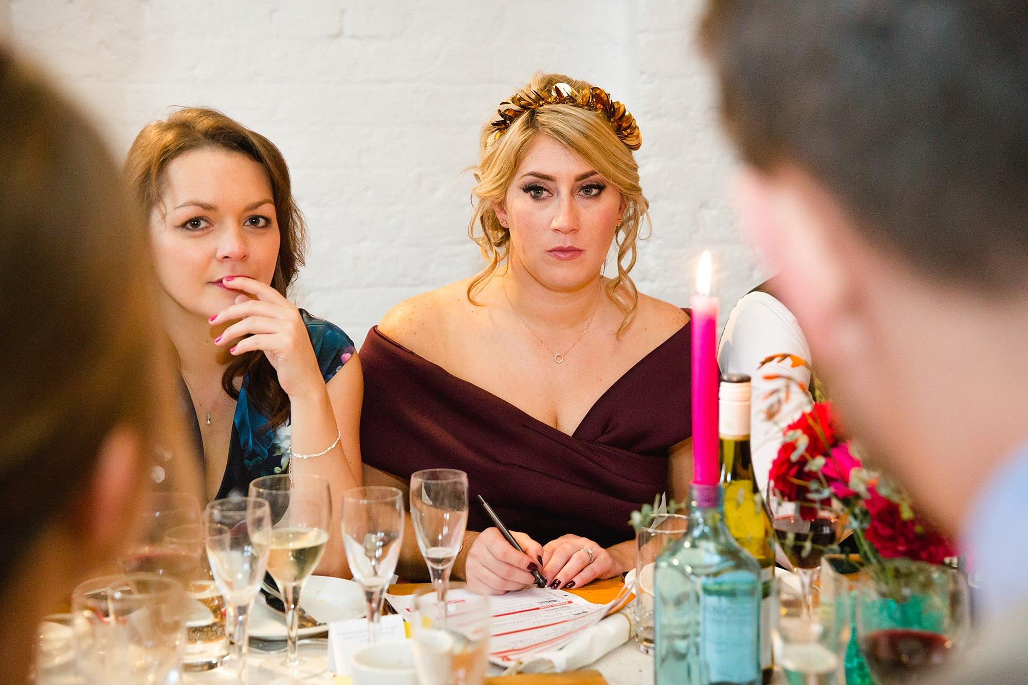 Fun London Wedding portrait of bridesmaid doing a quiz