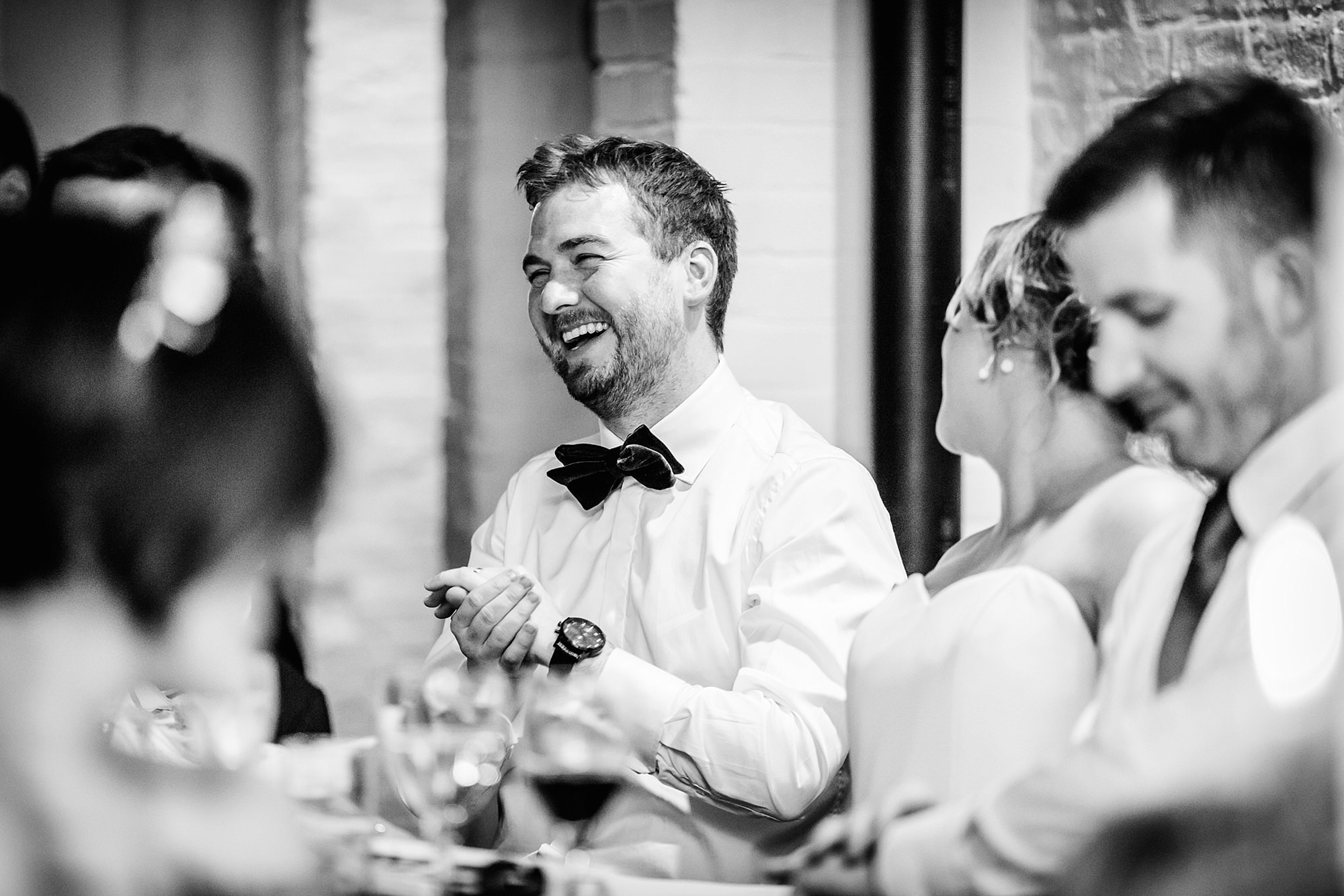 Fun London Wedding portrait of groom laughing during speeches