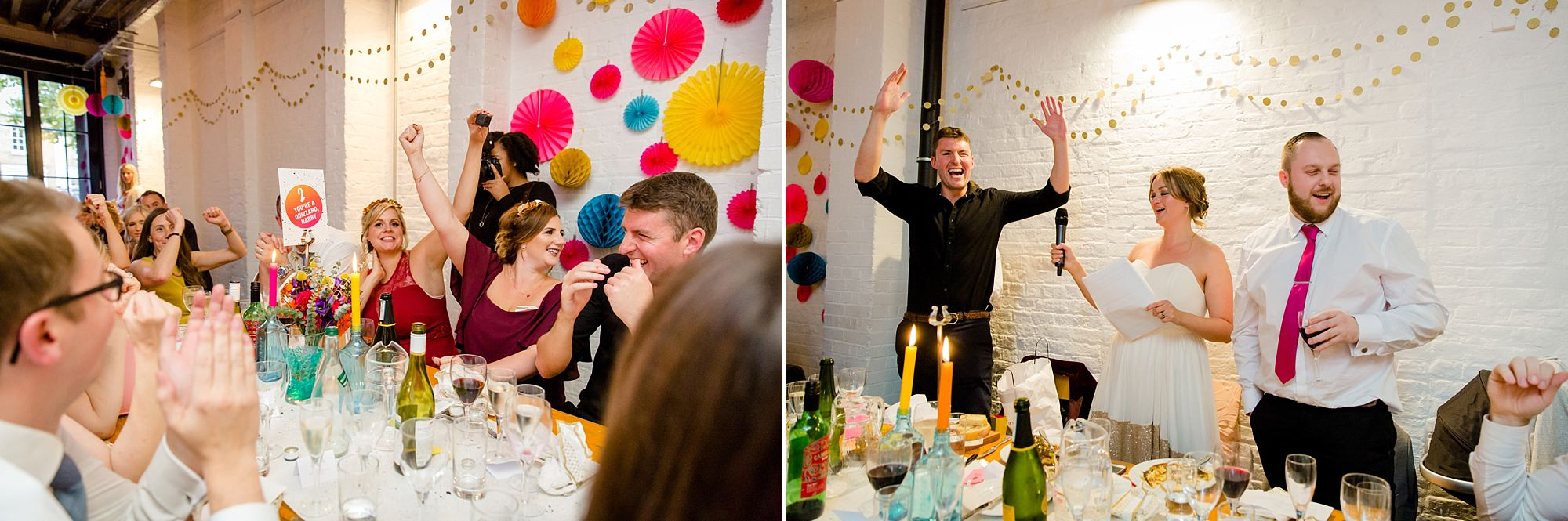 Fun London Wedding guests cheering as they win the quiz