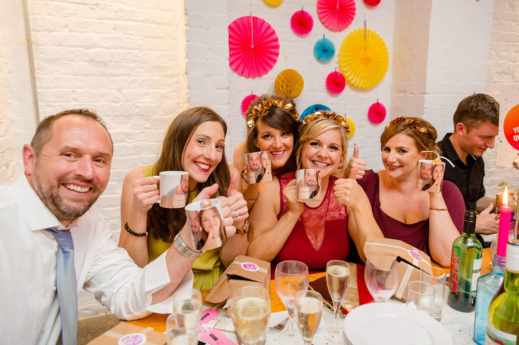 Fun London Wedding guests show off their bride and groom personalised mugs