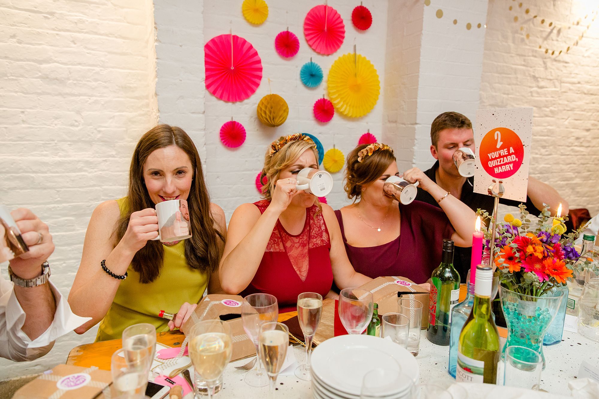 Fun London Wedding guests do shots from personalised mugs