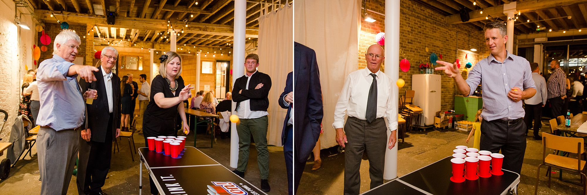 Fun London Wedding guests play beer pong at brixton east