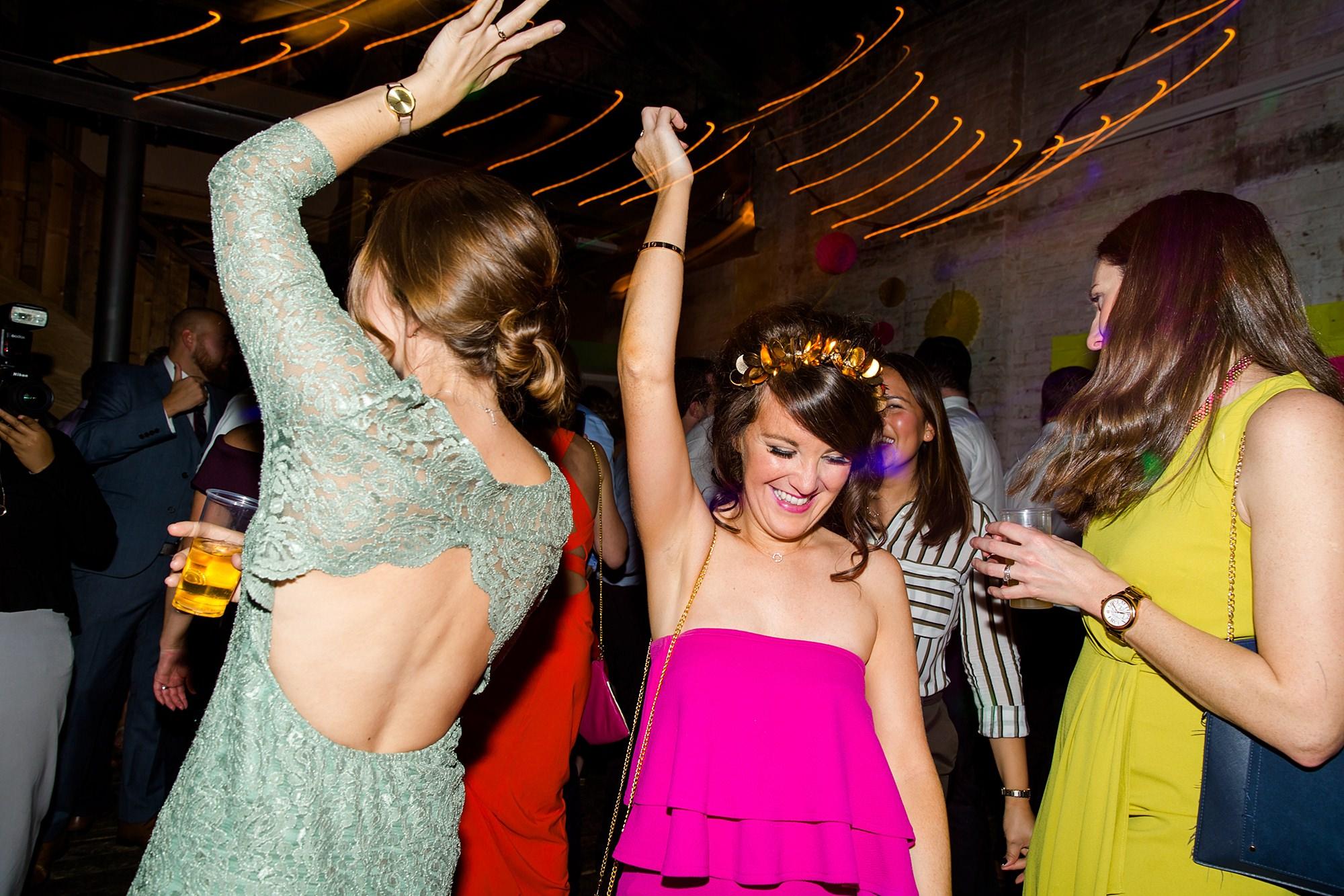 Fun London Wedding bridesmaid laughing and dancing at brixton east
