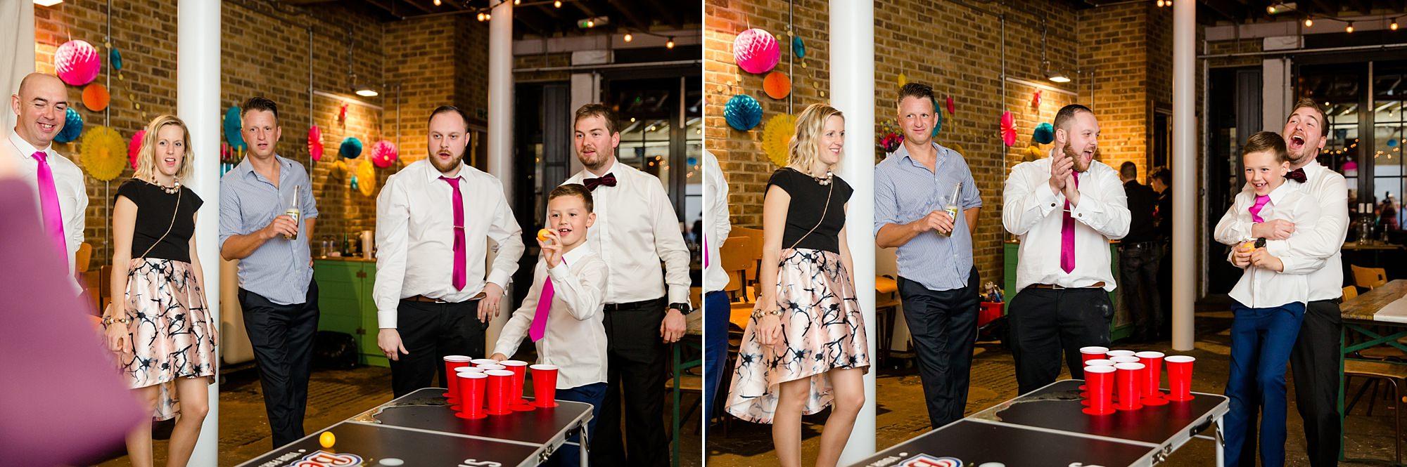 Fun London Wedding guests play beer pong with groom