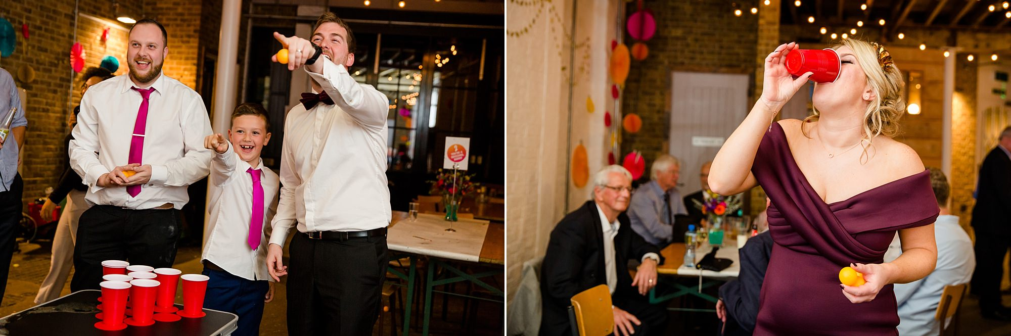 Fun London Wedding guests cheer as they play beer pong