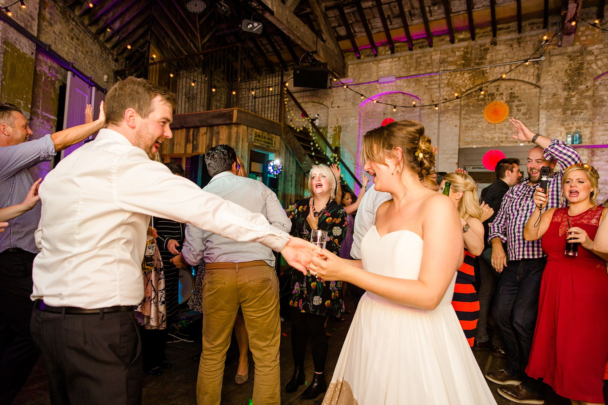 Fun London Wedding bride and groom dance together in brixton east