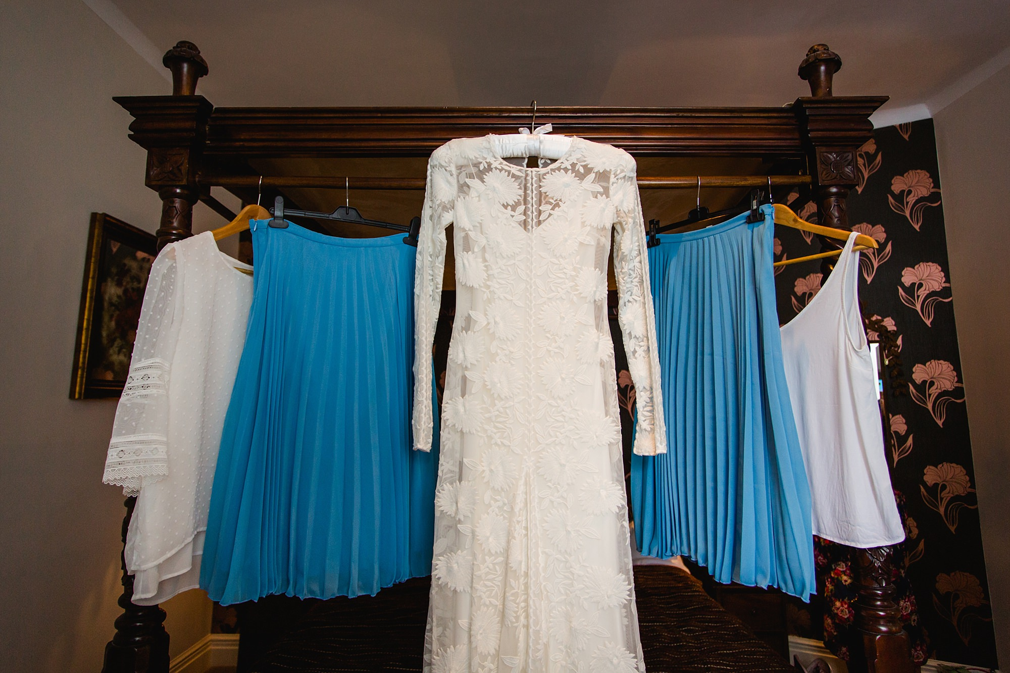 Isis Farmhouse Oxford Wedding bride and bridesmaids dresses hung up