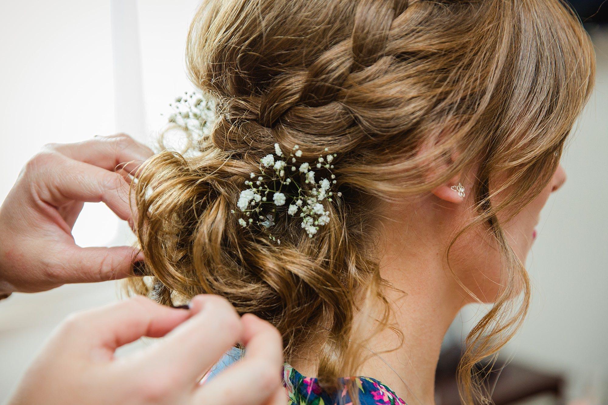 Isis Farmhouse Oxford Wedding a bridesmaid has flowers put in her hair