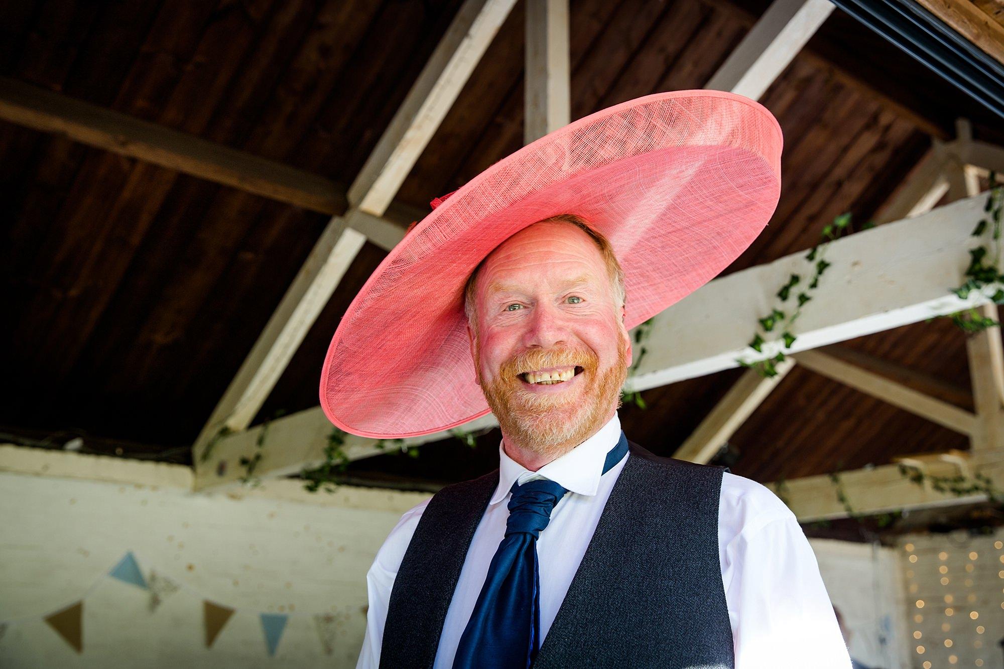 Isis Farmhouse Oxford Wedding fun portrait of father of bride in fancy wedding hat