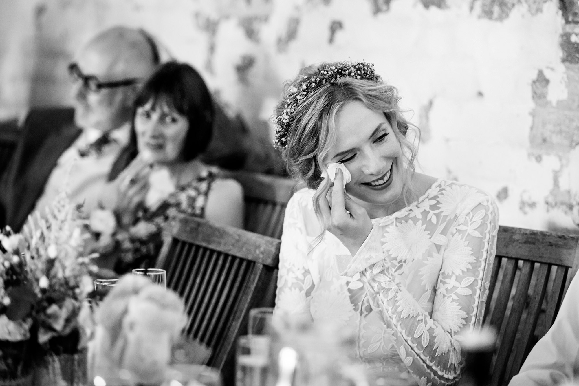 Isis Farmhouse Oxford Wedding bride reacts with a tear to groom's speech
