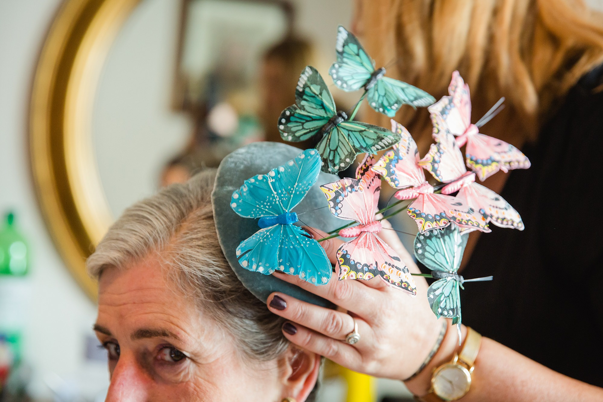 Isis Farmhouse Oxford Wedding close up detail of mother of the bride's butterfly hairpiece