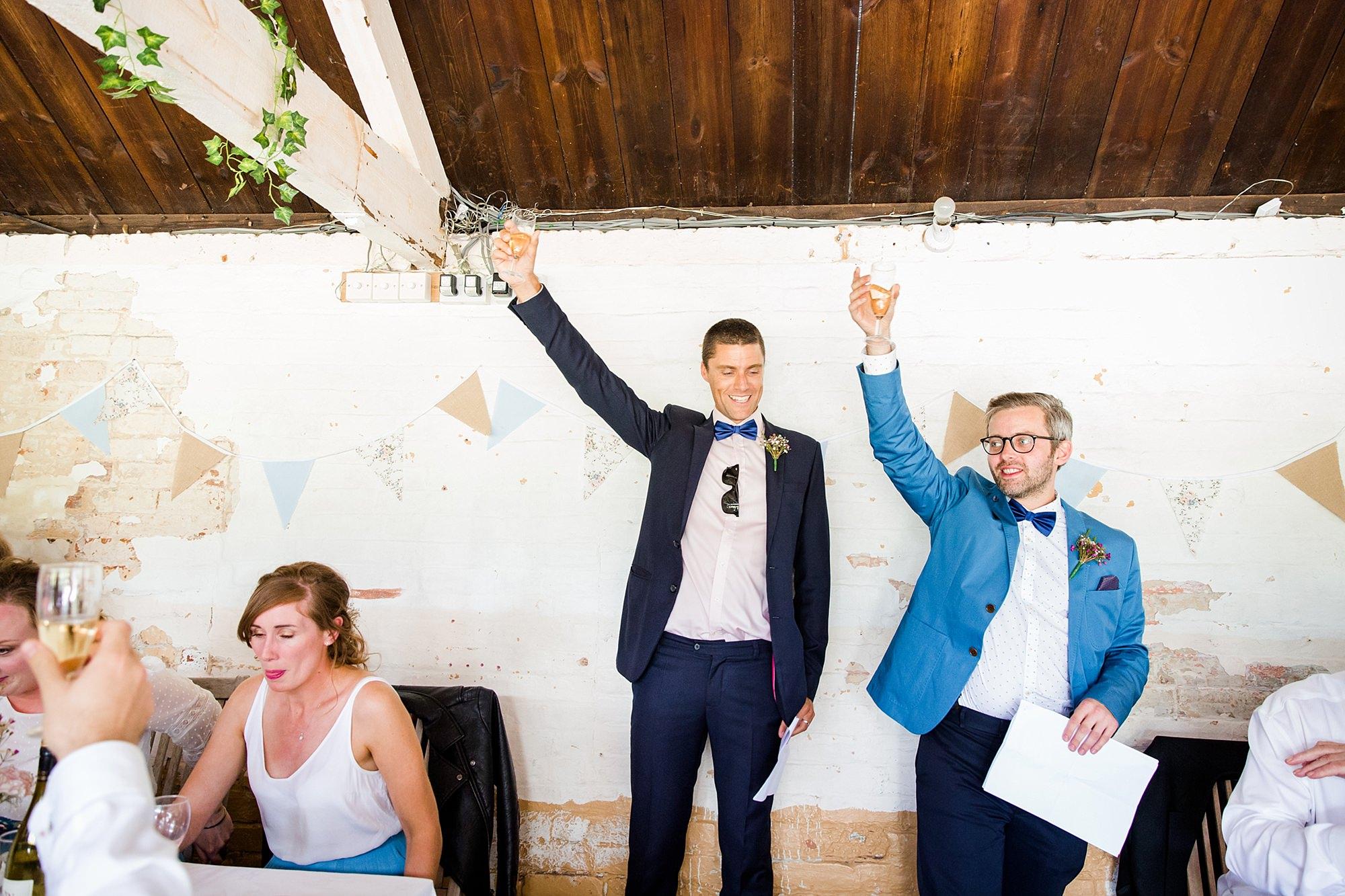 Isis Farmhouse Oxford Wedding groomsmen make a toast
