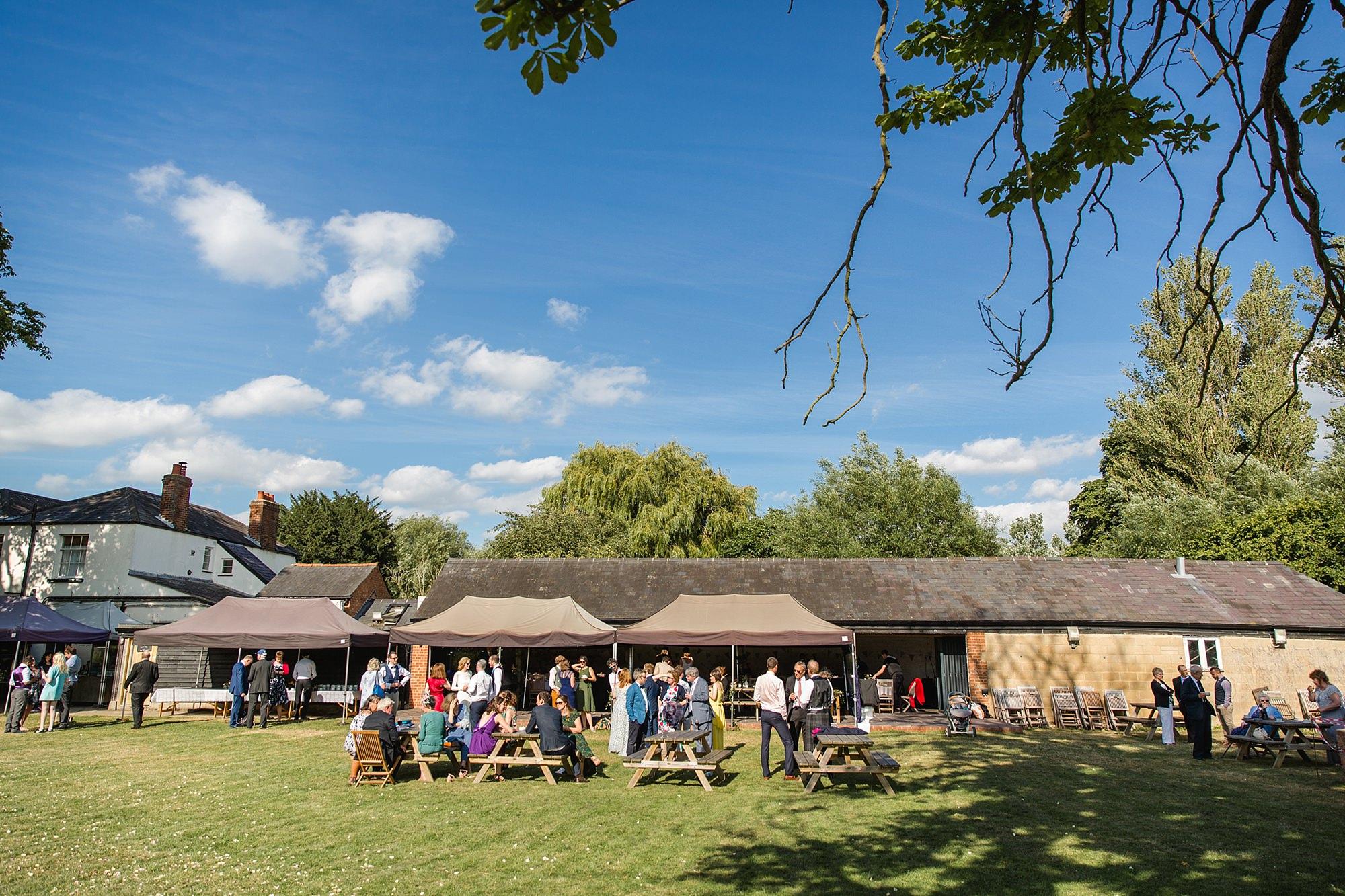 Isis Farmhouse Oxford Wedding outdoors at the farmhouse
