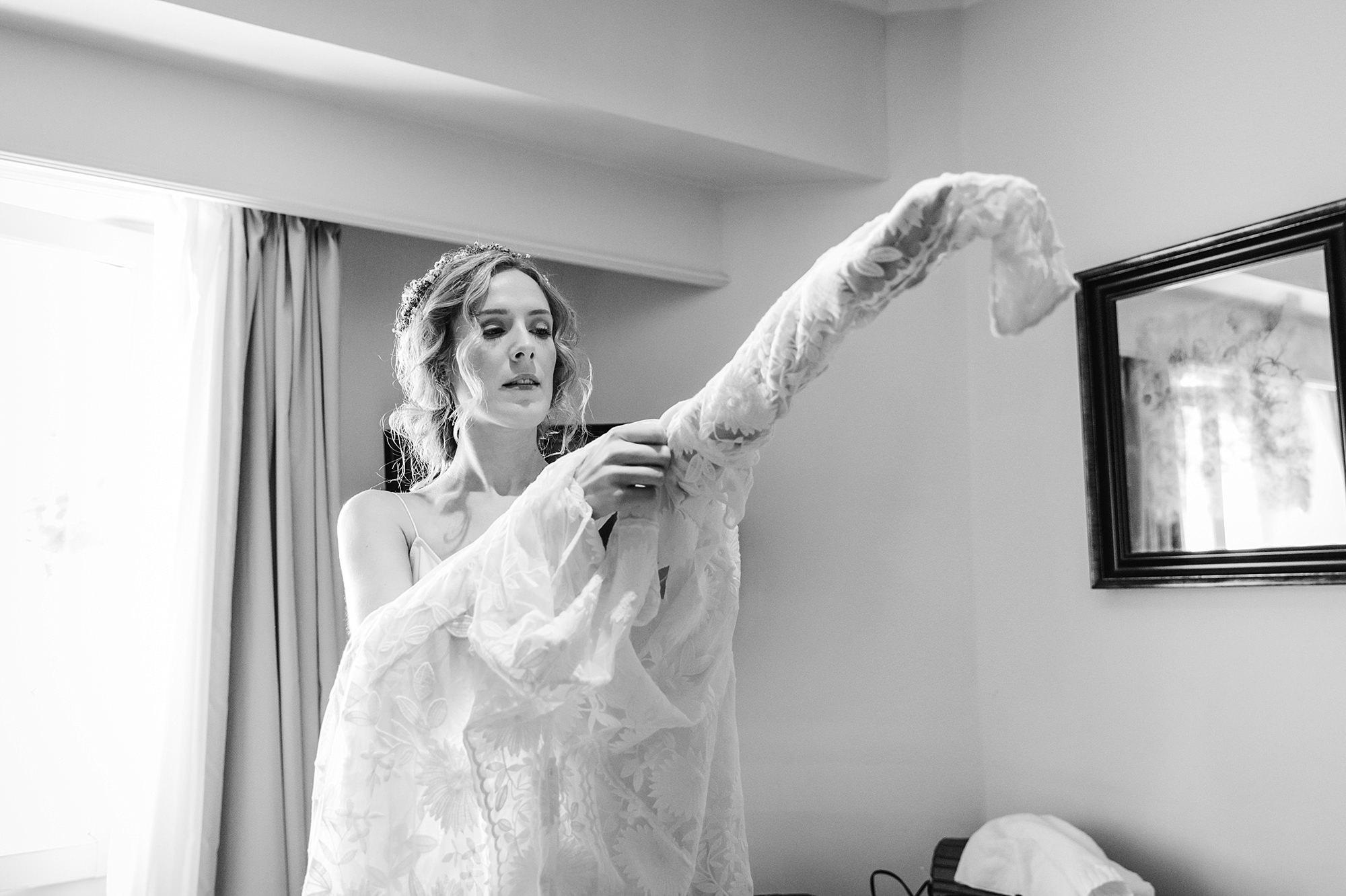 Isis Farmhouse Oxford Wedding portrait of bride pulling on her wedding dress
