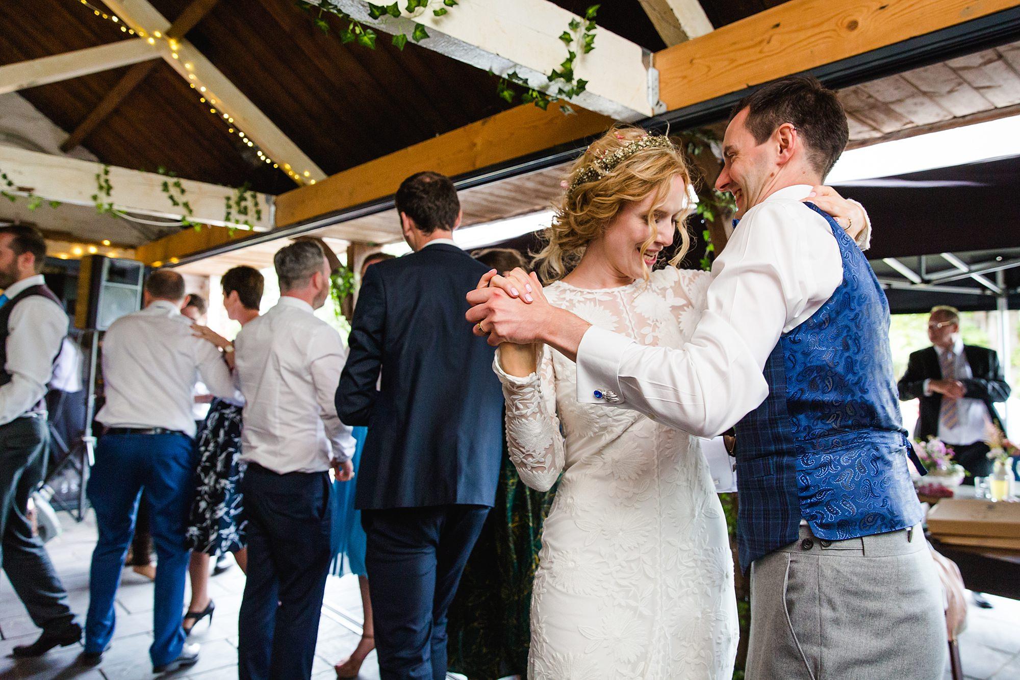 Isis Farmhouse Oxford Wedding bride and groom dance in a ceilidh