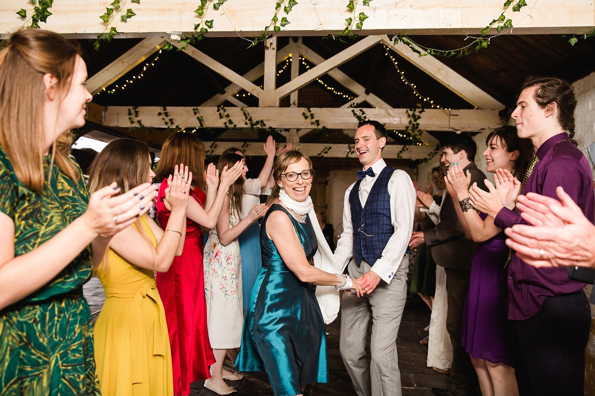 Isis Farmhouse Oxford Wedding groom dances in ceilidh