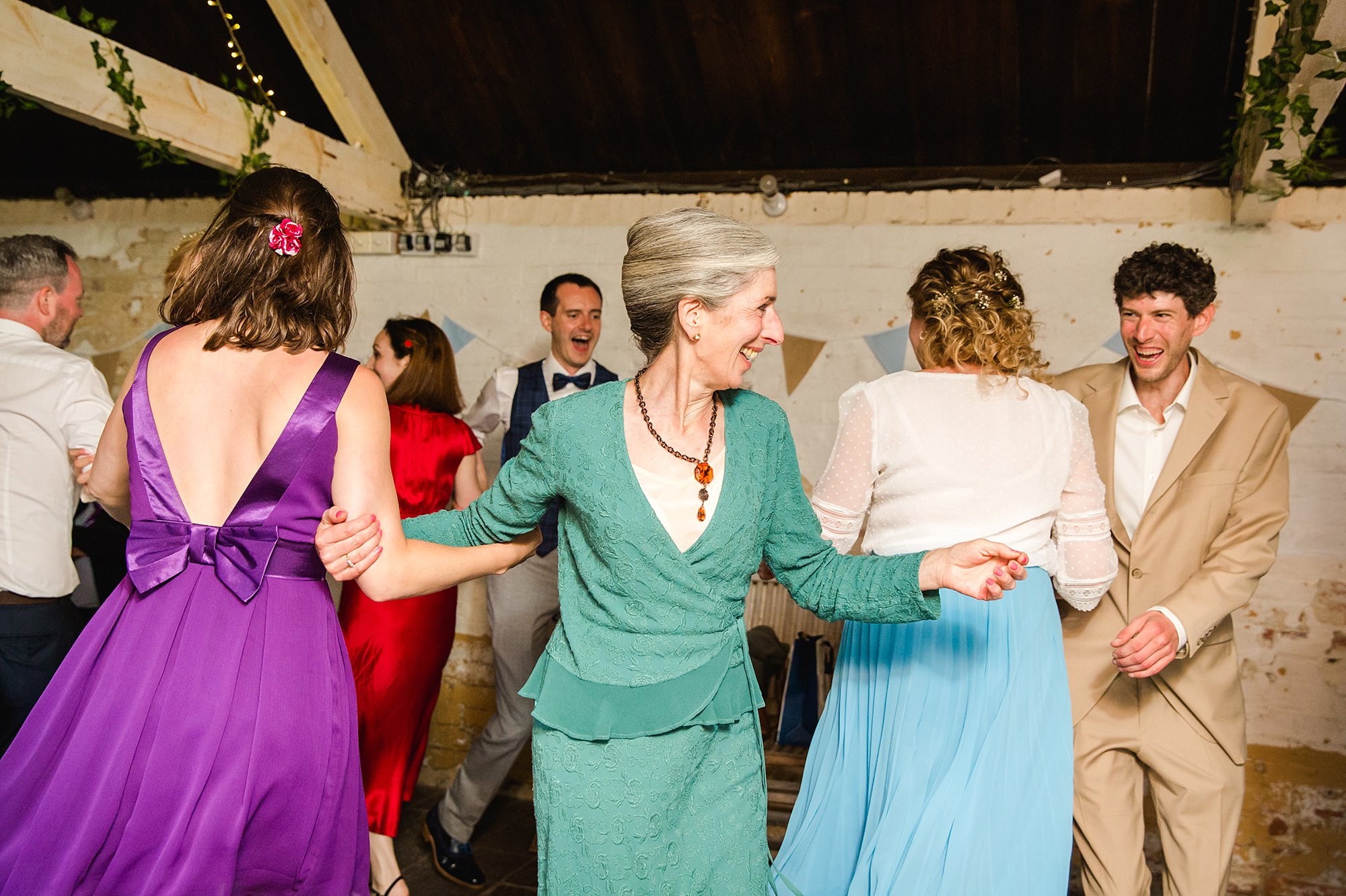Isis Farmhouse Oxford Wedding ceilidh dancing