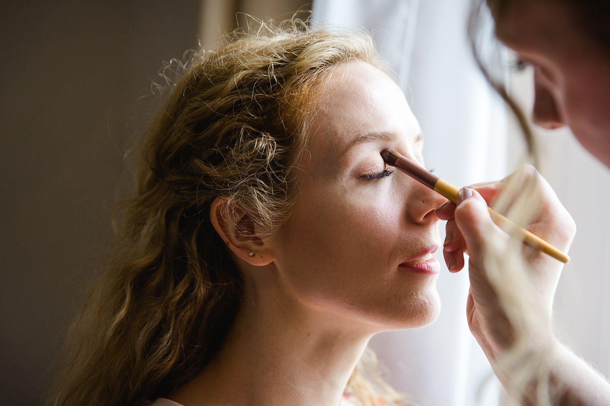 Isis Farmhouse Oxford Wedding a bride had makeup applied