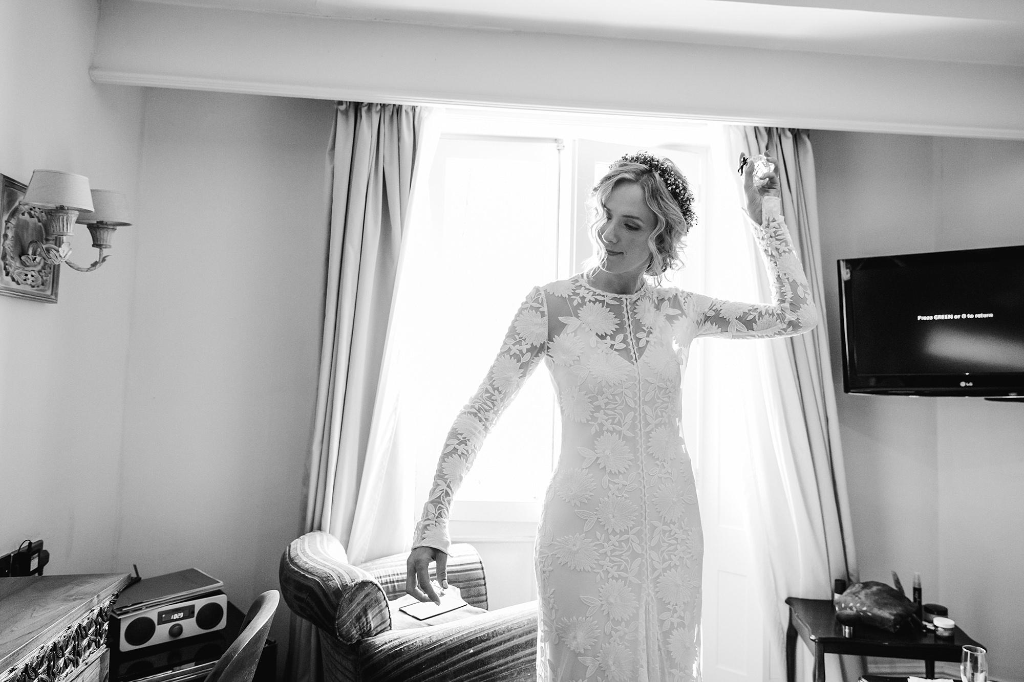 Isis Farmhouse Oxford Wedding portrait of bride spraying perfume as she gets ready