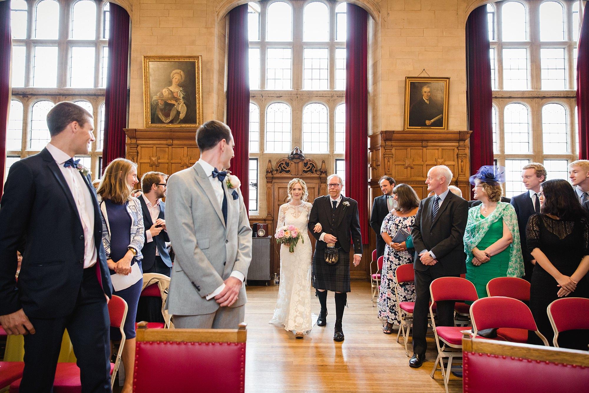 Isis Farmhouse Oxford Wedding portrait of bride walking down the aisle at oxford town hal