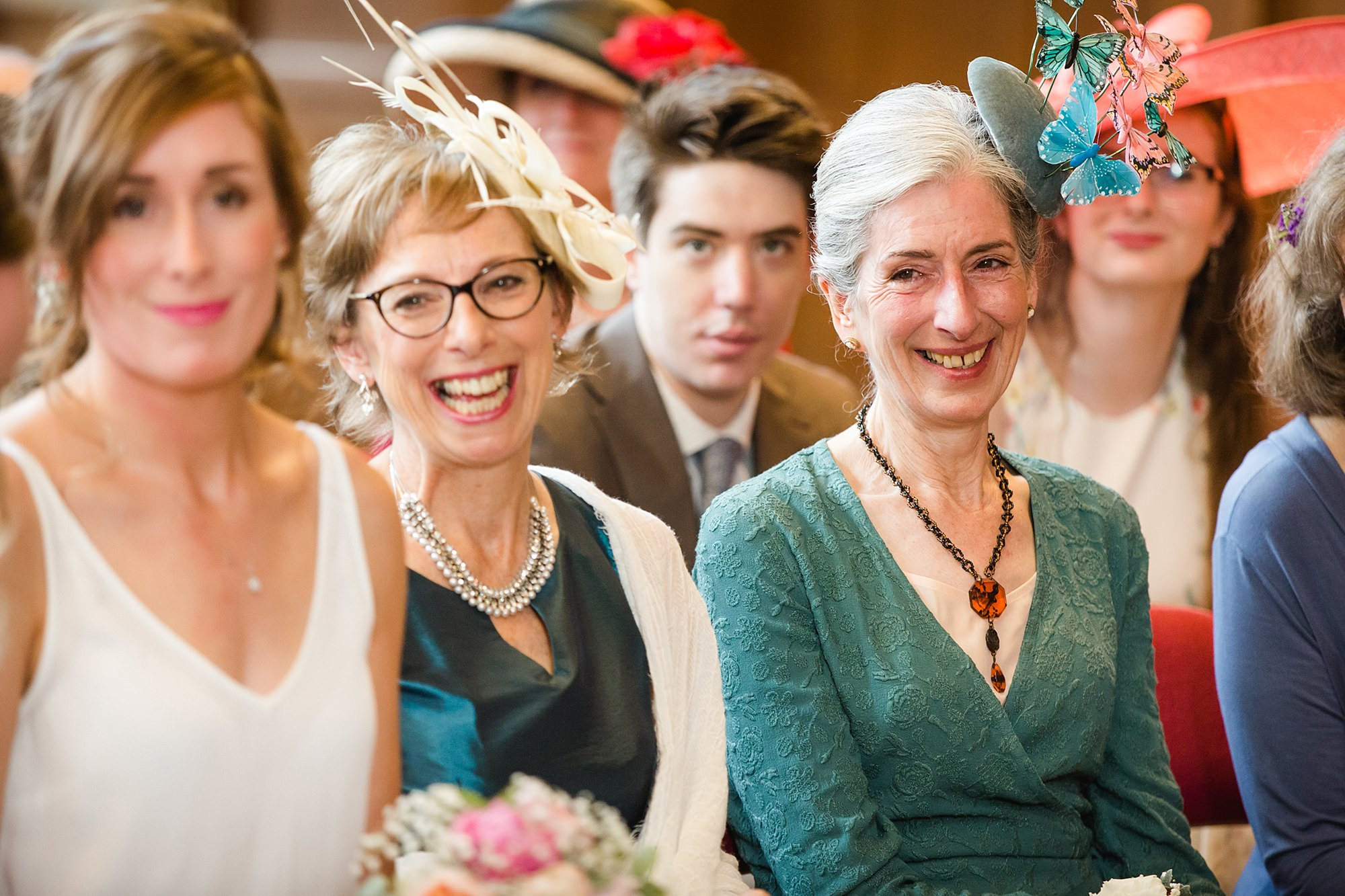 Isis Farmhouse Oxford Wedding guests laugh during wedding ceremony