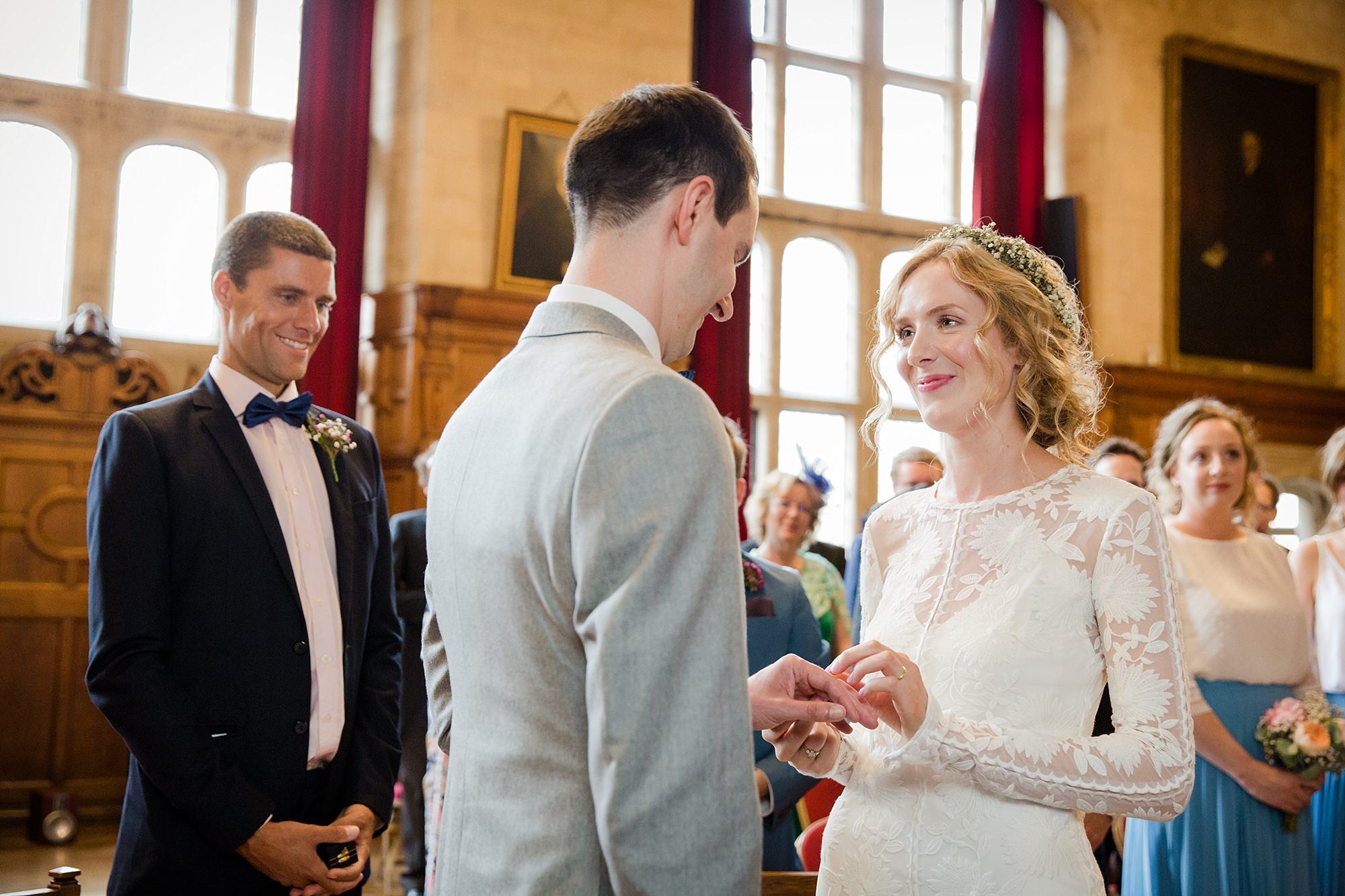 Isis Farmhouse Oxford Wedding portrait of groom and bride exchanging rings