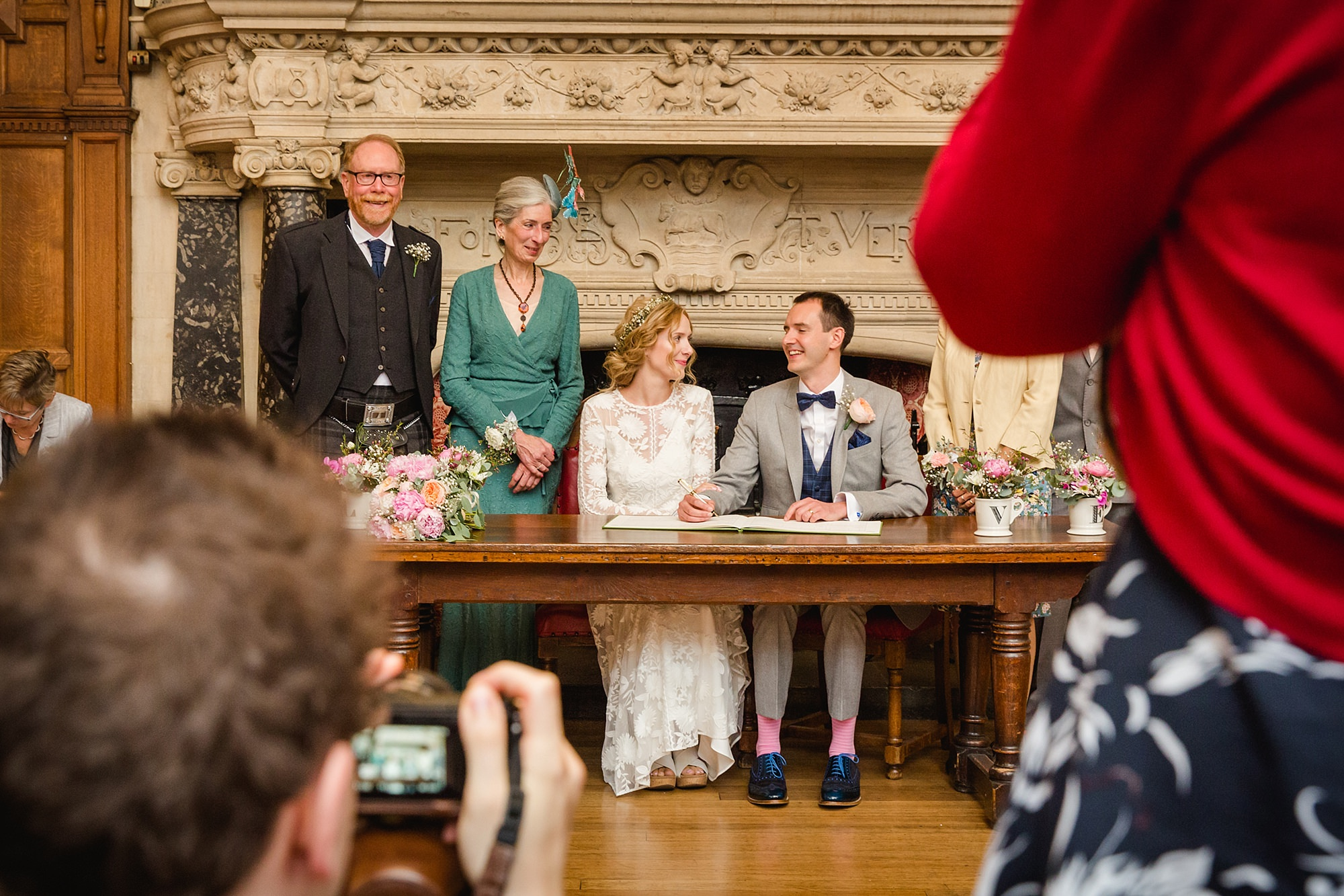 Isis Farmhouse Oxford Wedding wedding guests take picture of bride and groom signing register