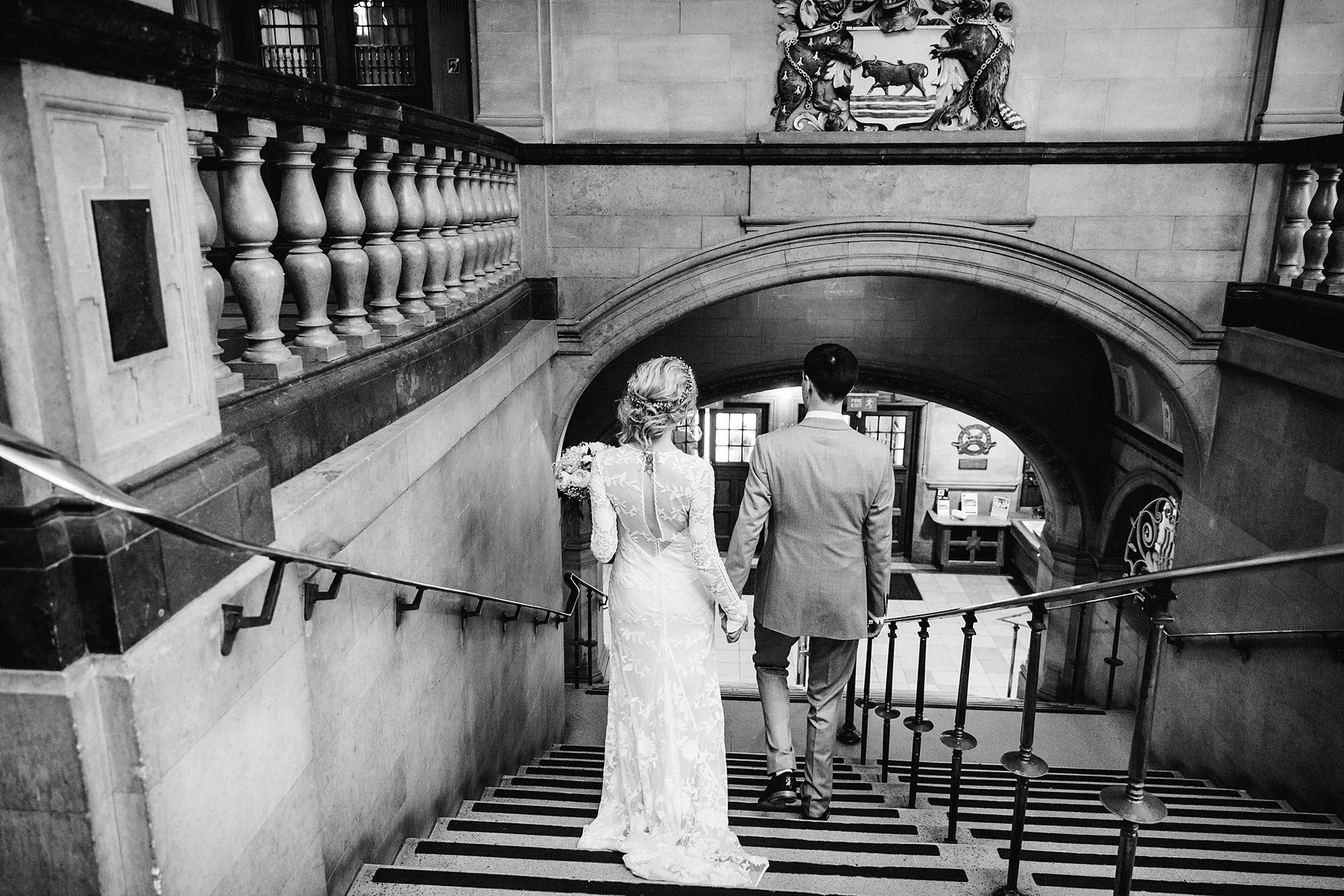 Isis Farmhouse Oxford Wedding bride and groom walk down oxford town hall steps