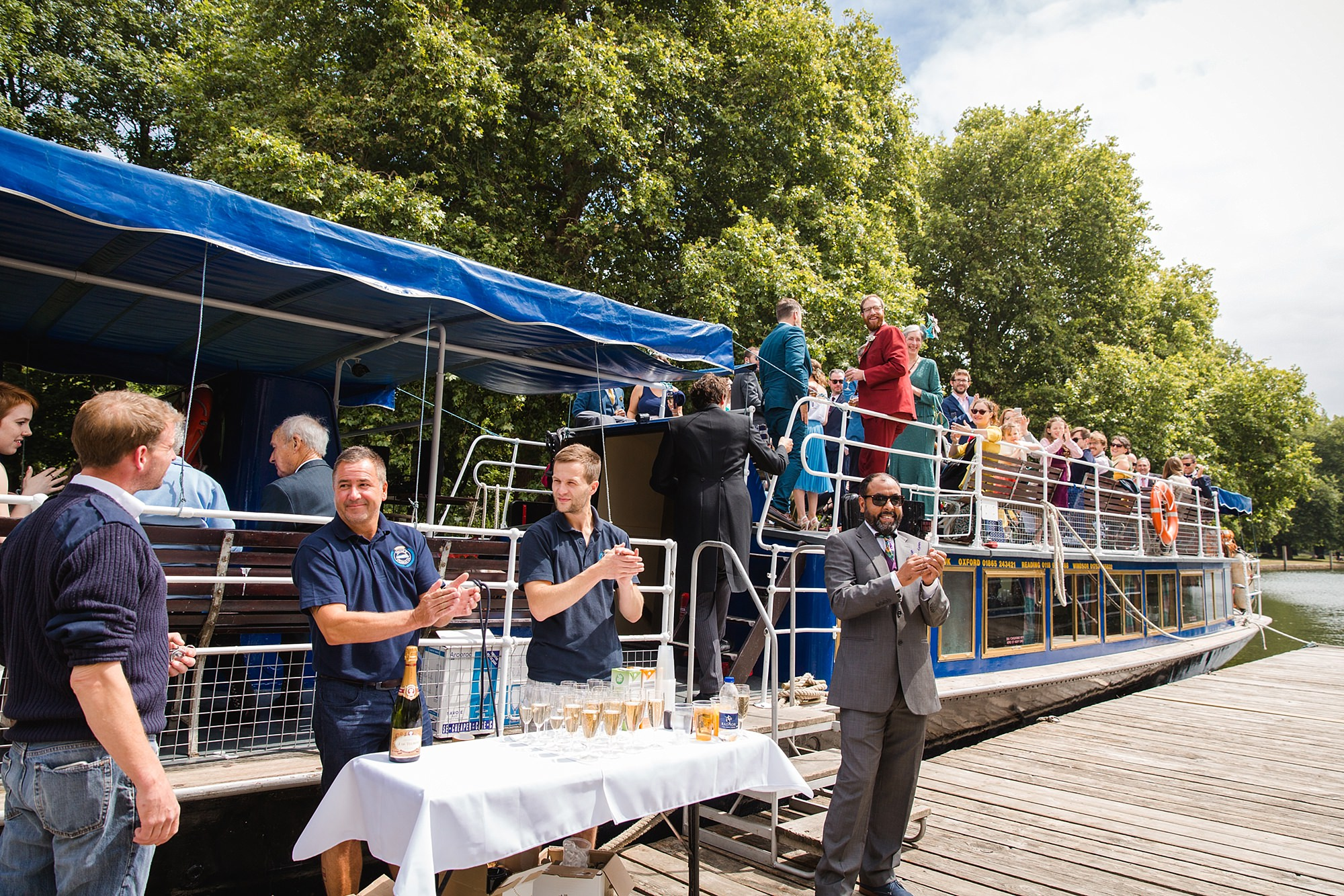 Isis Farmhouse Oxford Wedding guests welcome bride and room onto boat