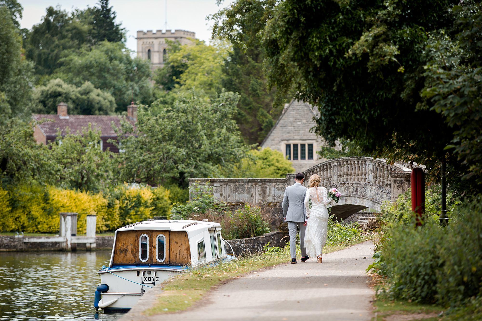 Isis Farmhouse Oxford Wedding bride and groom walk towards bride at isis farmhouse