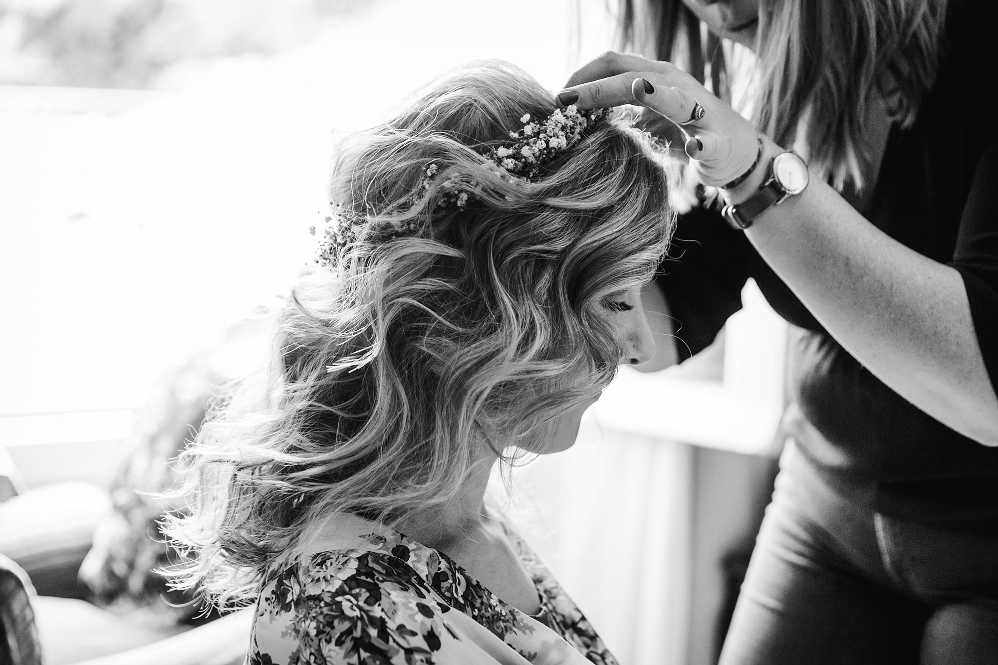 Isis Farmhouse Oxford Wedding portrait of bride having flower crown put on