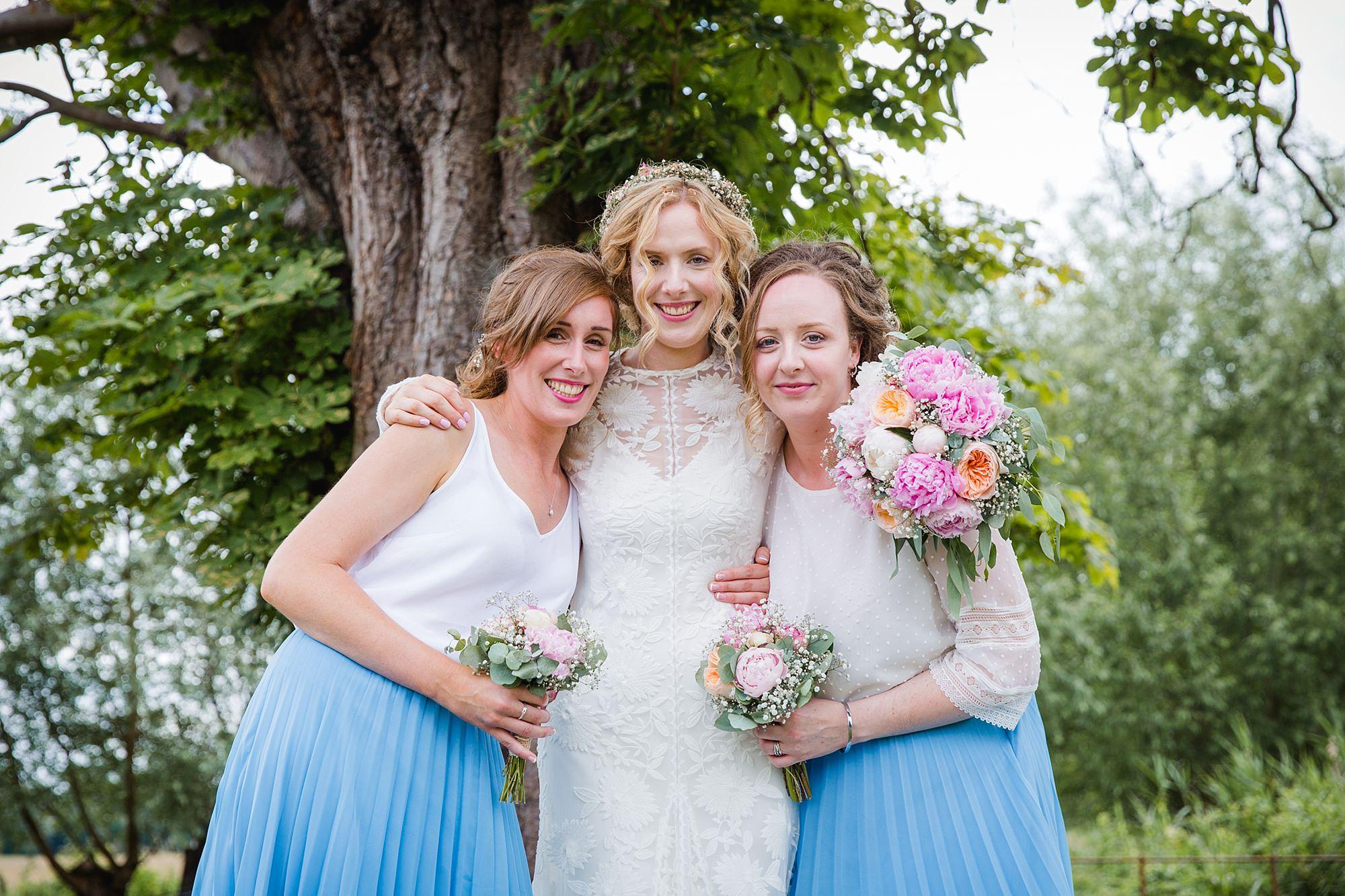 Isis Farmhouse Oxford Wedding portrait of bride with bridesmaids