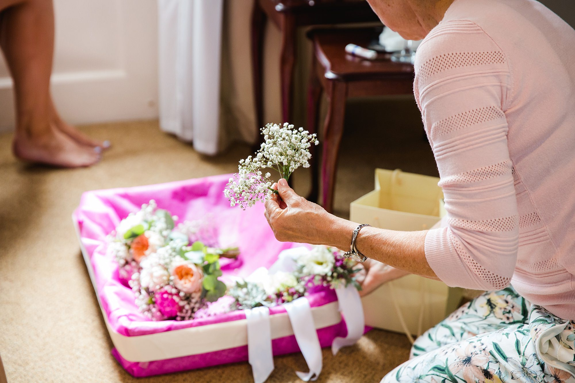 Isis Farmhouse Oxford Wedding collecting flowers to put in bridesmaid's hair