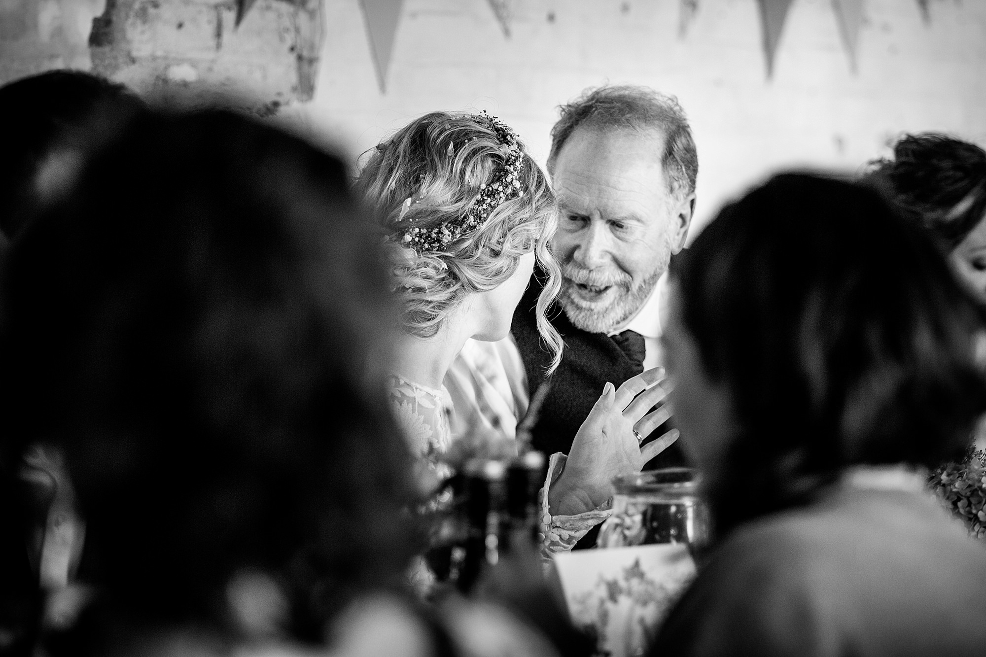 Isis Farmhouse Oxford Wedding documentary portrait of bride talkie to her father