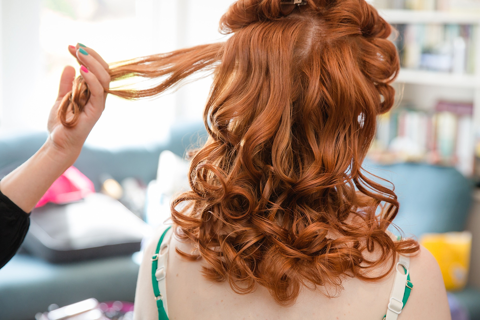 oyster shed wedding a bride has her curls brushed