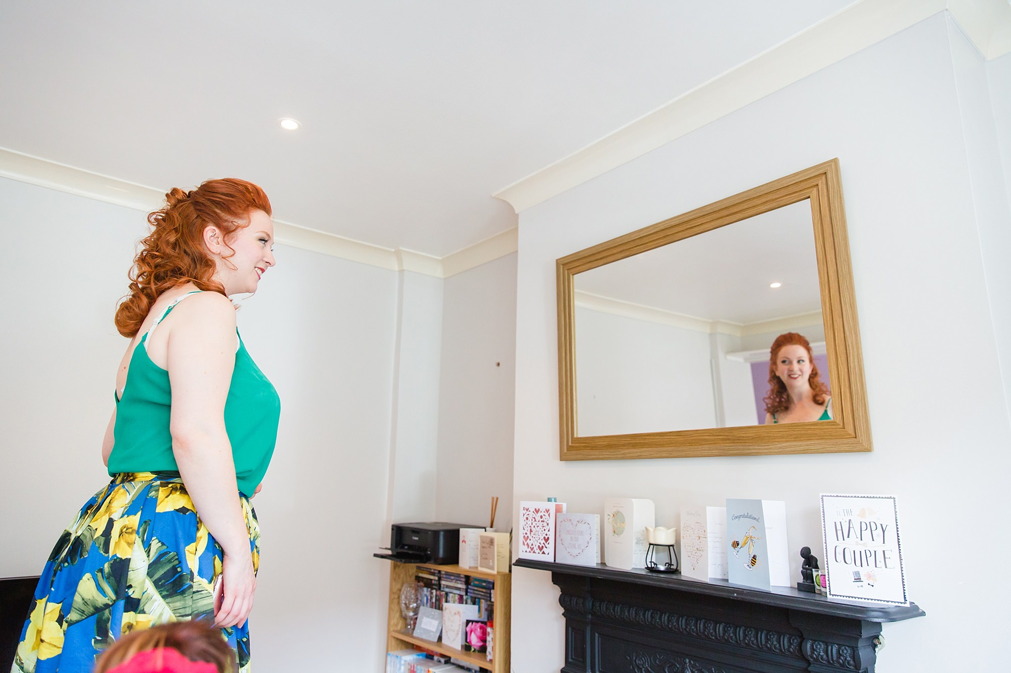 oyster shed wedding bride sees finished hair and makeup in the mirror